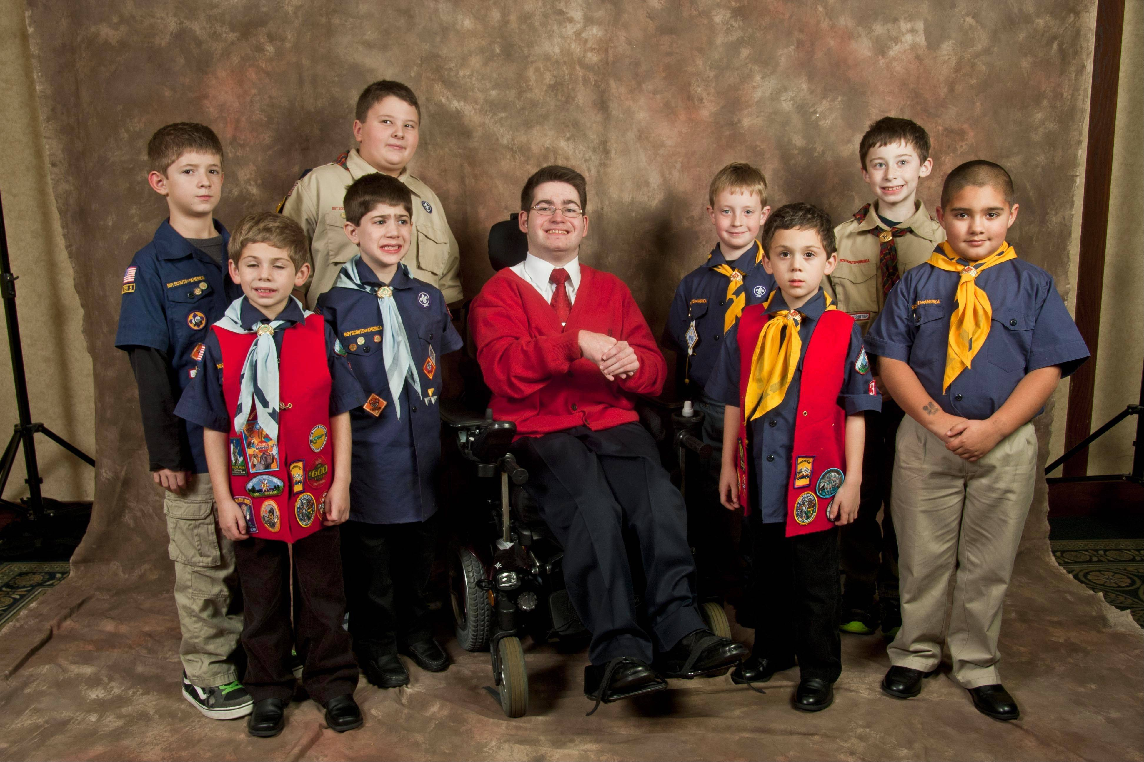 Members of Cub Scout Pack No. 36 pose with Avi Samuels, middle. The Scouts and Avi were co-winners of the Youth Volunteer award.