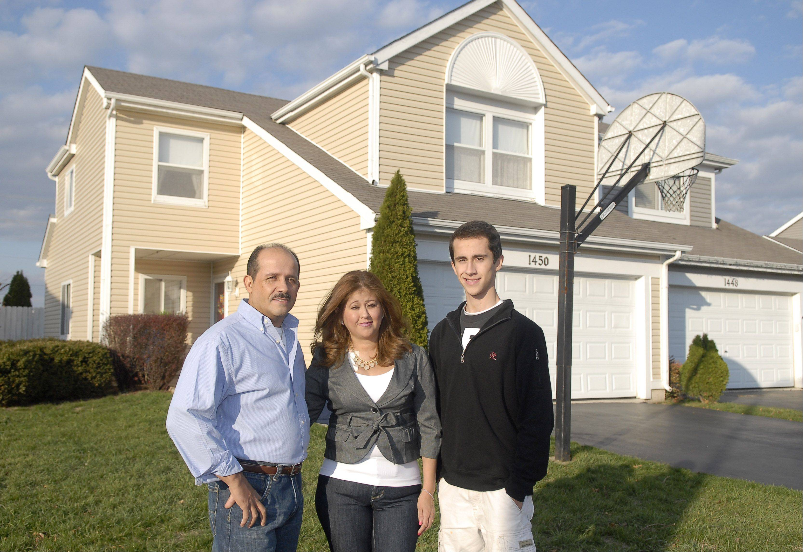 Evelio Villanueva, his wife, Irma, and son, Tavo, 16, in their South Elgin home. Villaneuva got a loan modification on his mortgage with the help of Neighborhood Housing Services of the Fox Valley. He says it wouldn't have been possible without the help of the organization.