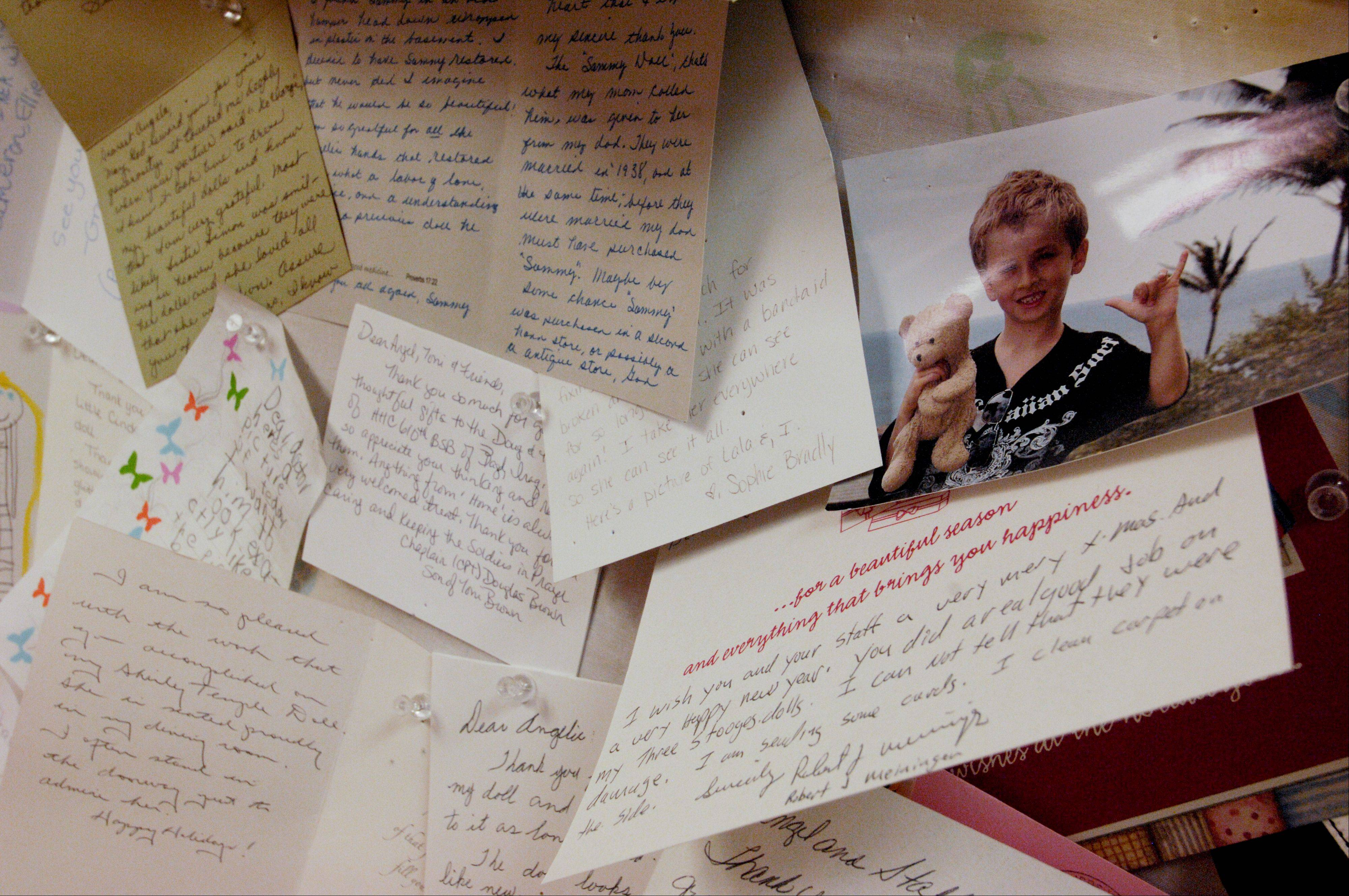 Handwritten thank-you letters from customers hang on the wall at Angelic Creations Doll Hospital in Naperville.