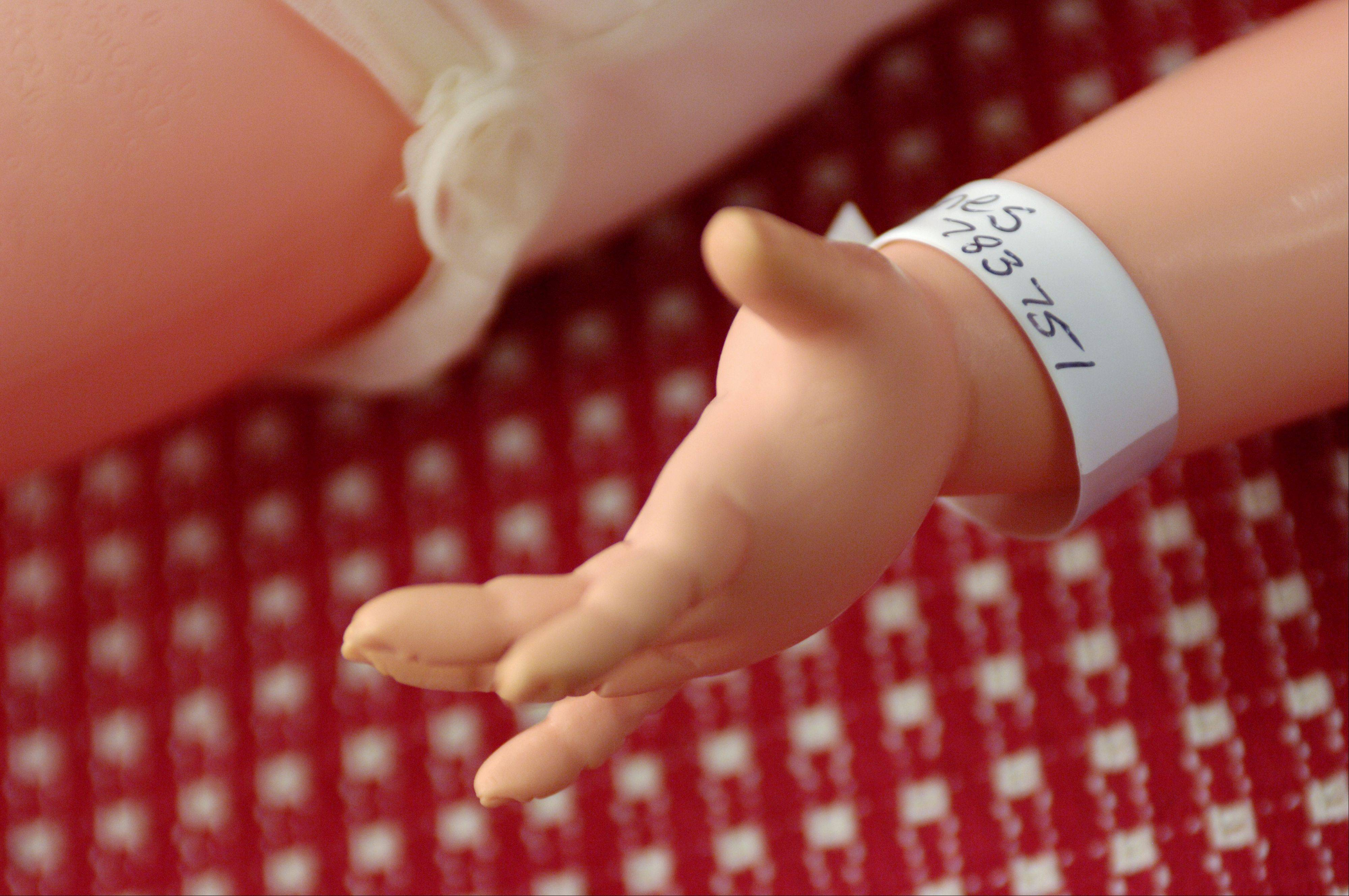 Every patient is given a hospital bracelet when they arrive at the Angelic Creations Doll Hospital in Naperville.