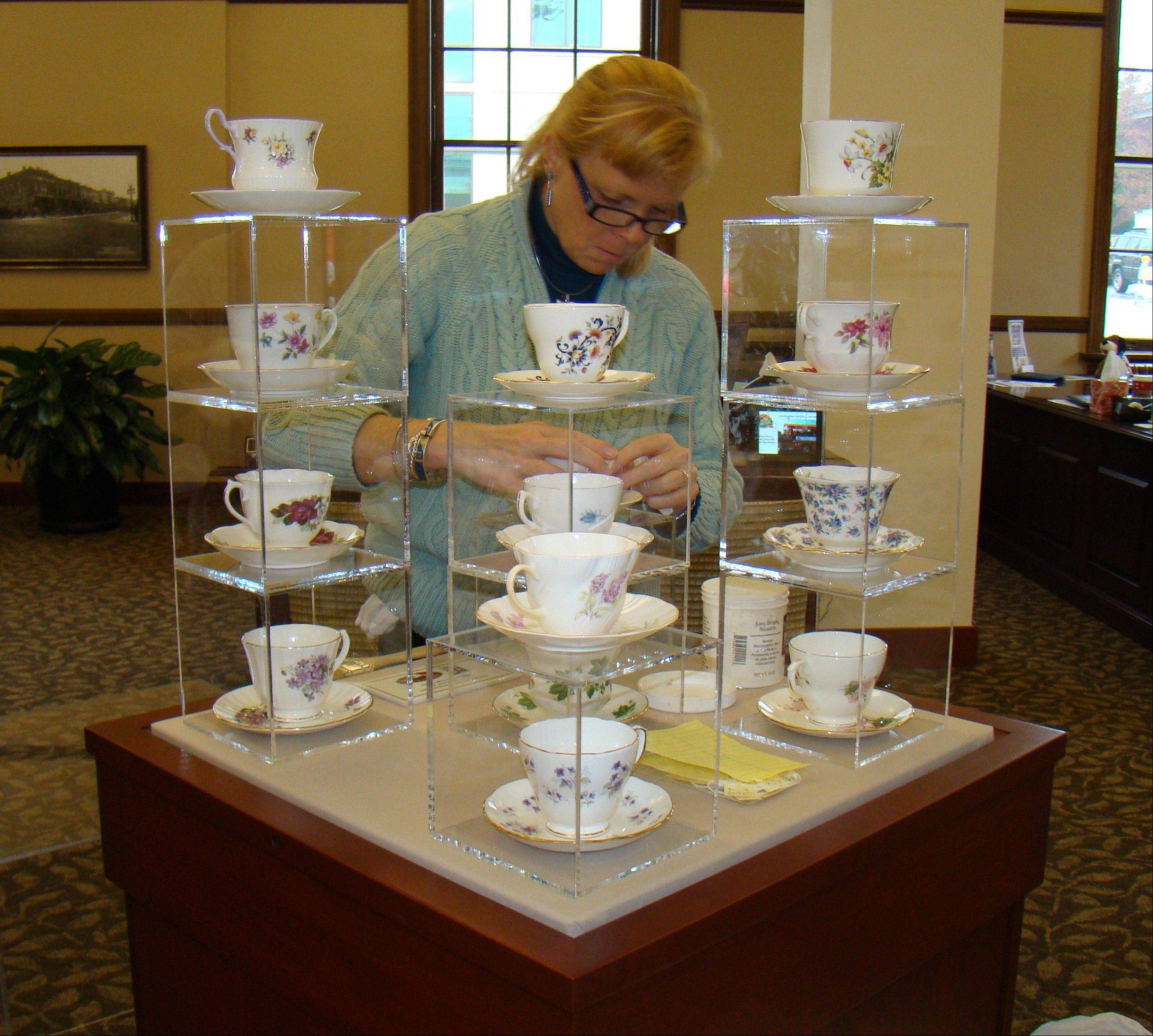 Naper Settlement's chief curator, Louise Howard, puts the finishing touches on one of the Cup of Cheer displays.