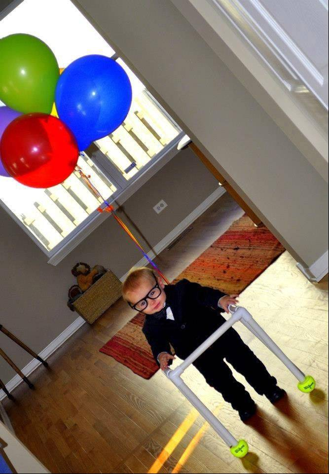 "One-year-old Austin Marshall is dressed as Mr. Fredrickson from the movie ""UP!"" as he goes out for his first Halloween in Round Lake."