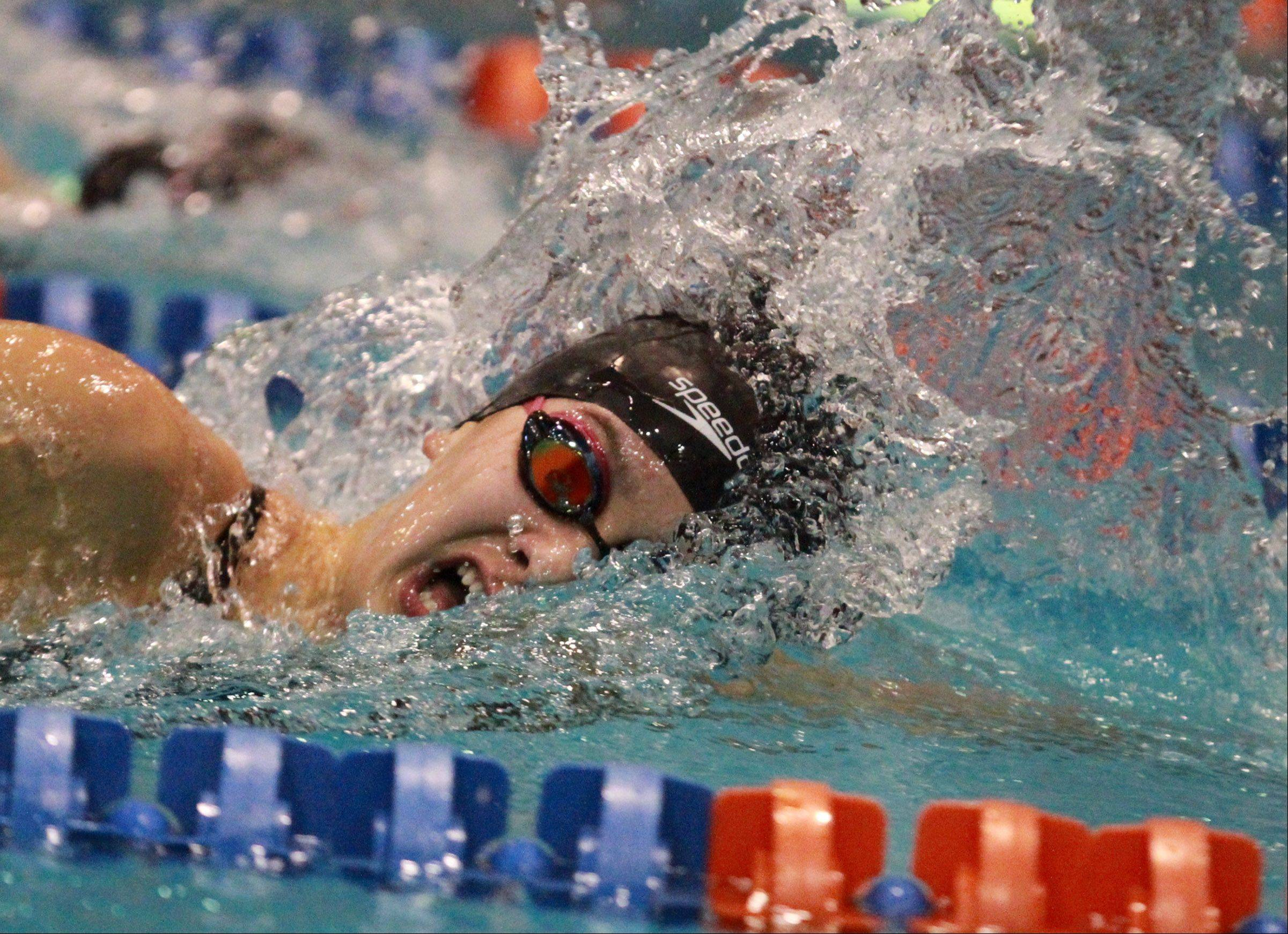 Stevenson's Julia Wawer delivers the fifth-best time of the day in the 200-yard freestyle at the state preliminaries in Evanston on Friday.