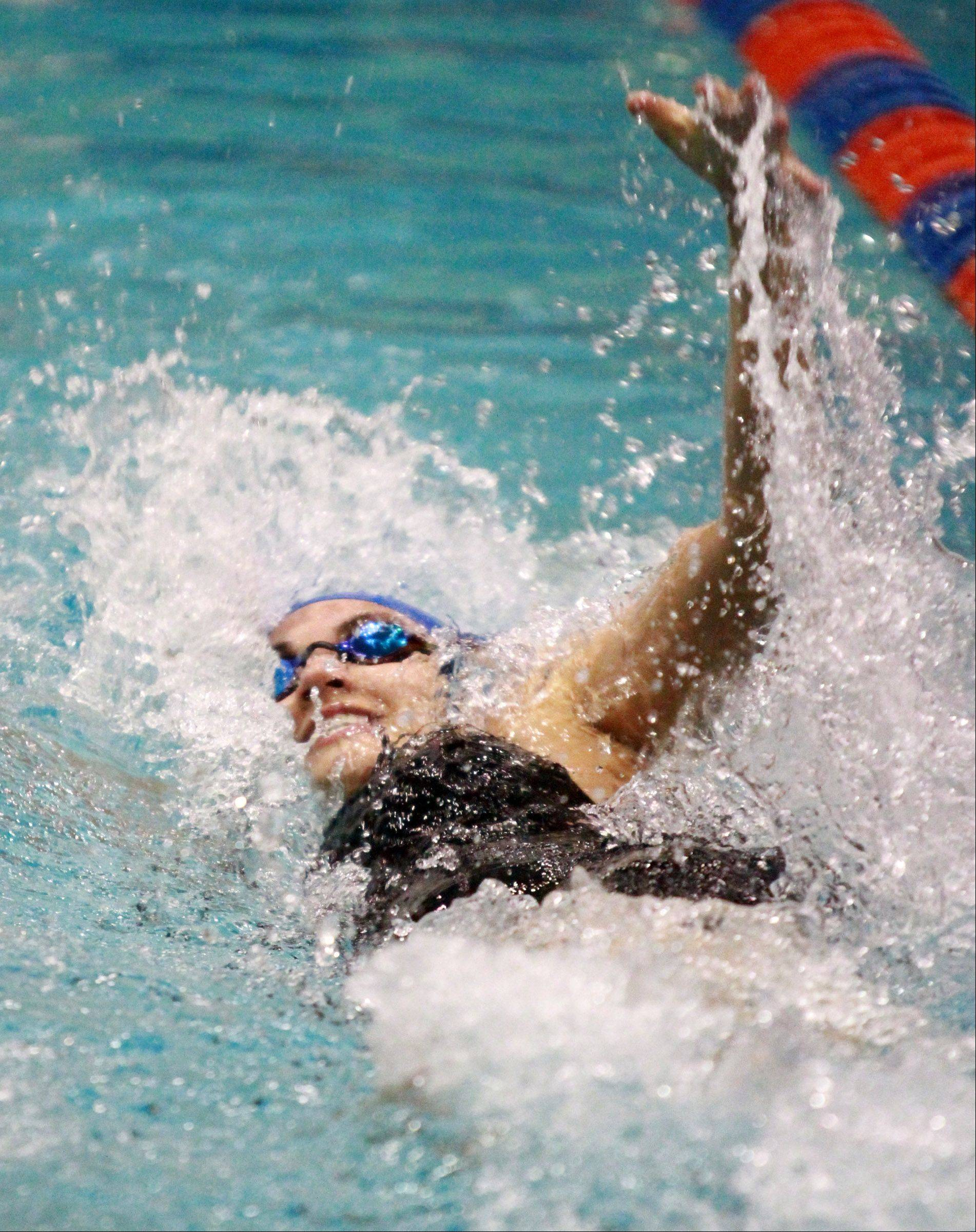 George LeClaire/gleclaire@dailyherald.comLakes' Madison Rinaldi swims the 100-yard backstroke at state preliminaries in Evanston on Friday.