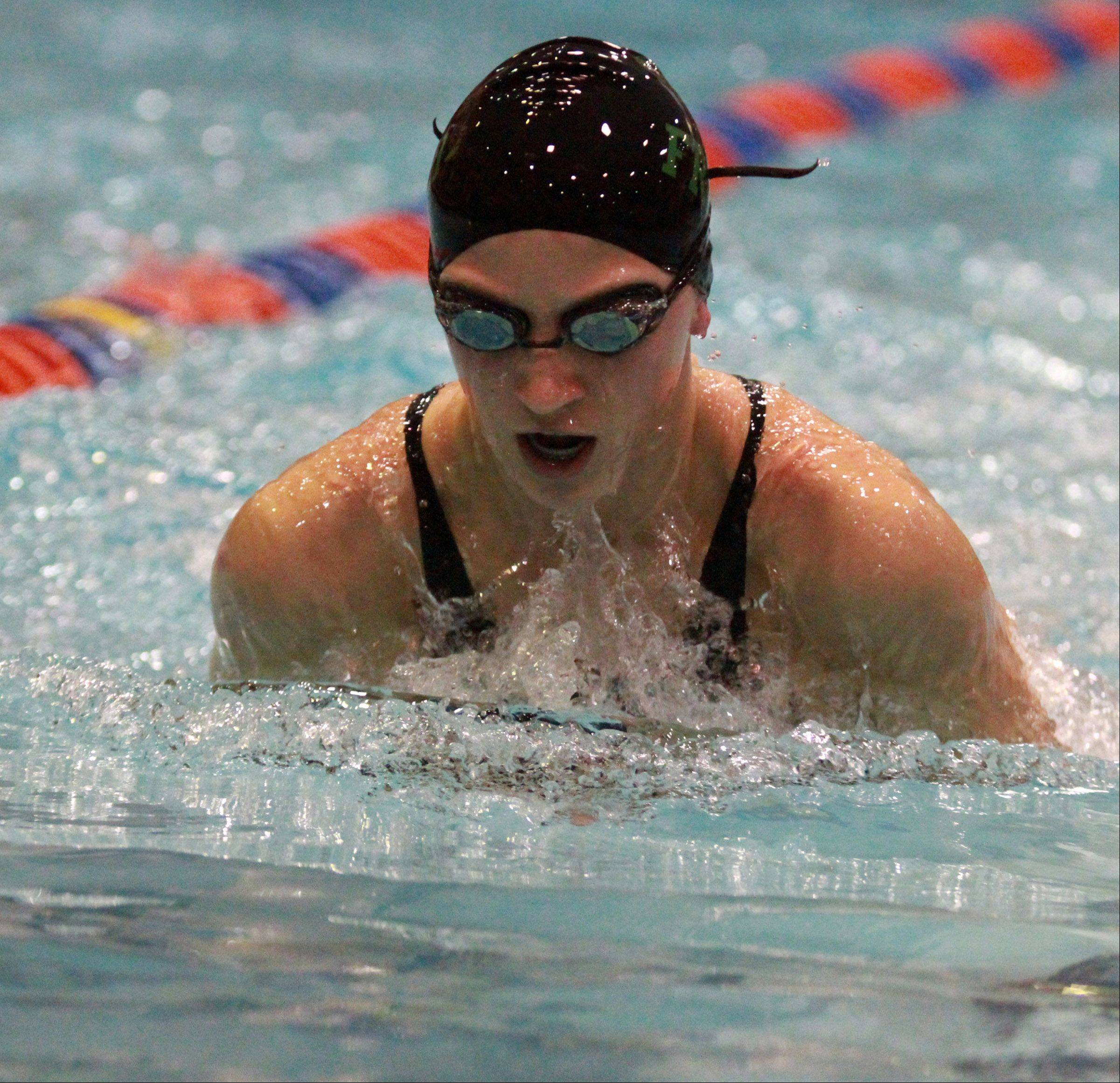 Leah Bloodgood swims the second leg of the 200-yard medley relay for Stevenson, which finished 11th in the event at state preliminaries in Evanston on Friday.