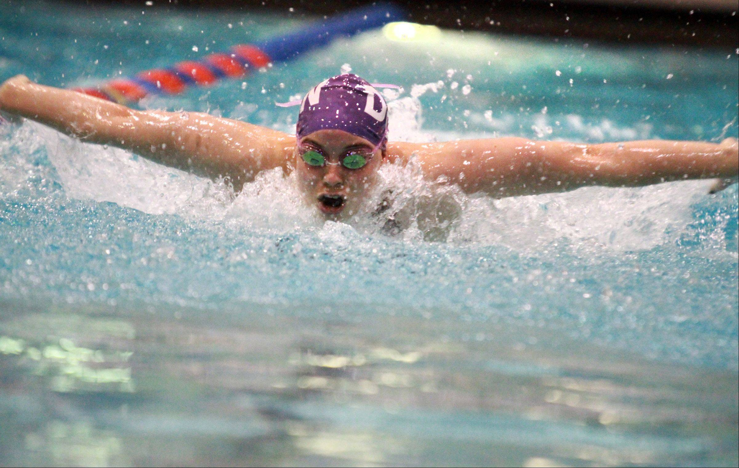 Maddy Sims with Downers Grove North placed fifteenth in the 100-yard butterfly at state preliminaries in Evanston on Friday, November 15, 2012.