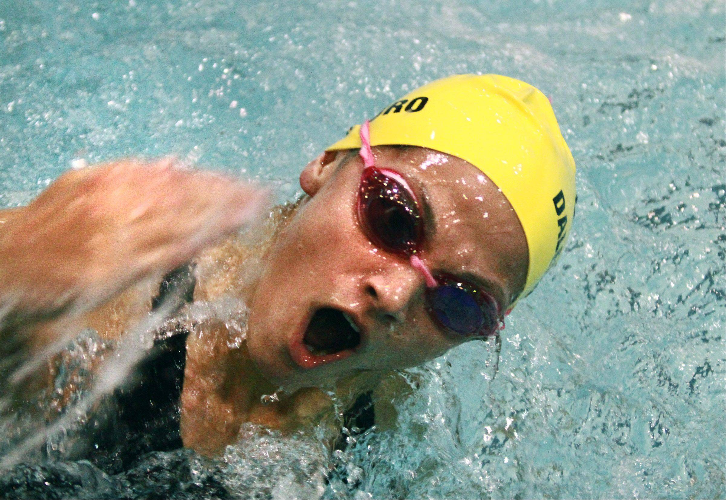 Gia Dalesandro of Neuqua Valley turns and kicks off the wall in the 100-yard butterfly.