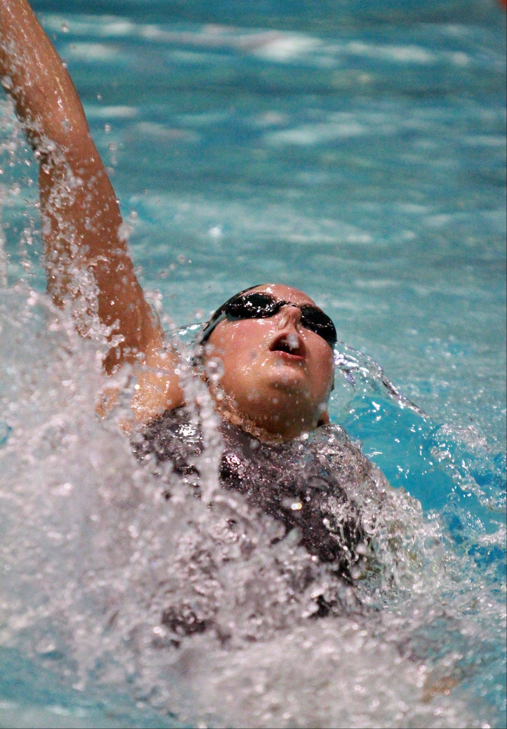 Kelly Lehane of Naperville Central swims the 100-yard backstroke.