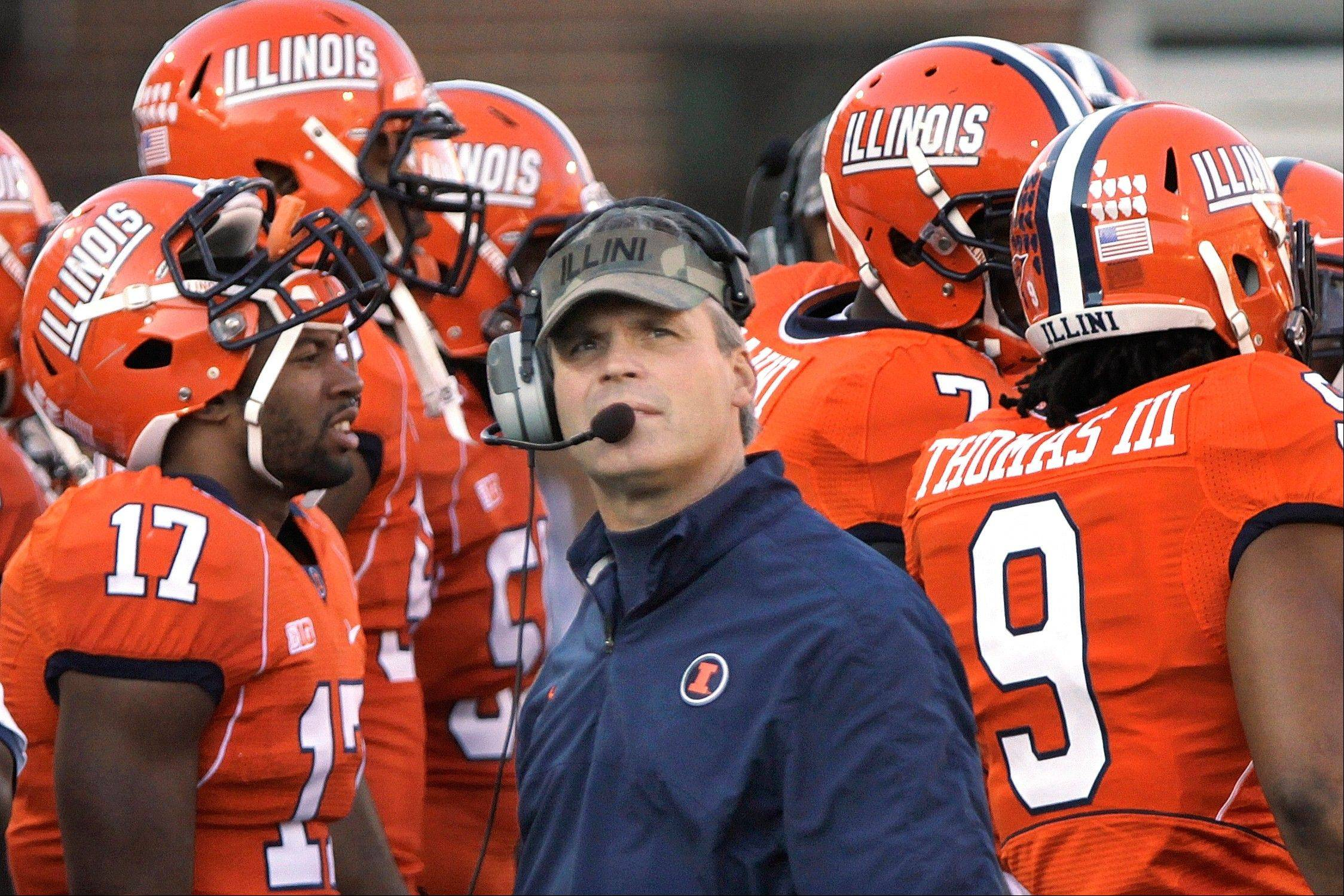 In this Nov. 10, 2012 photo, Illinois head coach Tim Beckman looks at the clock during a time out during the first half of an NCAA college football game between Illinois and Minnesota in Champaign, Ill. The Illini are the only Big Ten team without a conference win this season. Purdue plays at Illinois this Saturday, Nov. 17.