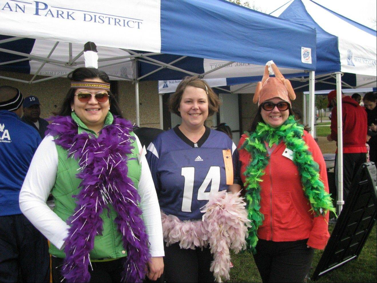 At the Waukegan Park District Turkey Trot are runners Alicia Giles, Aimee Emery-Ortiz and Jen Moore.