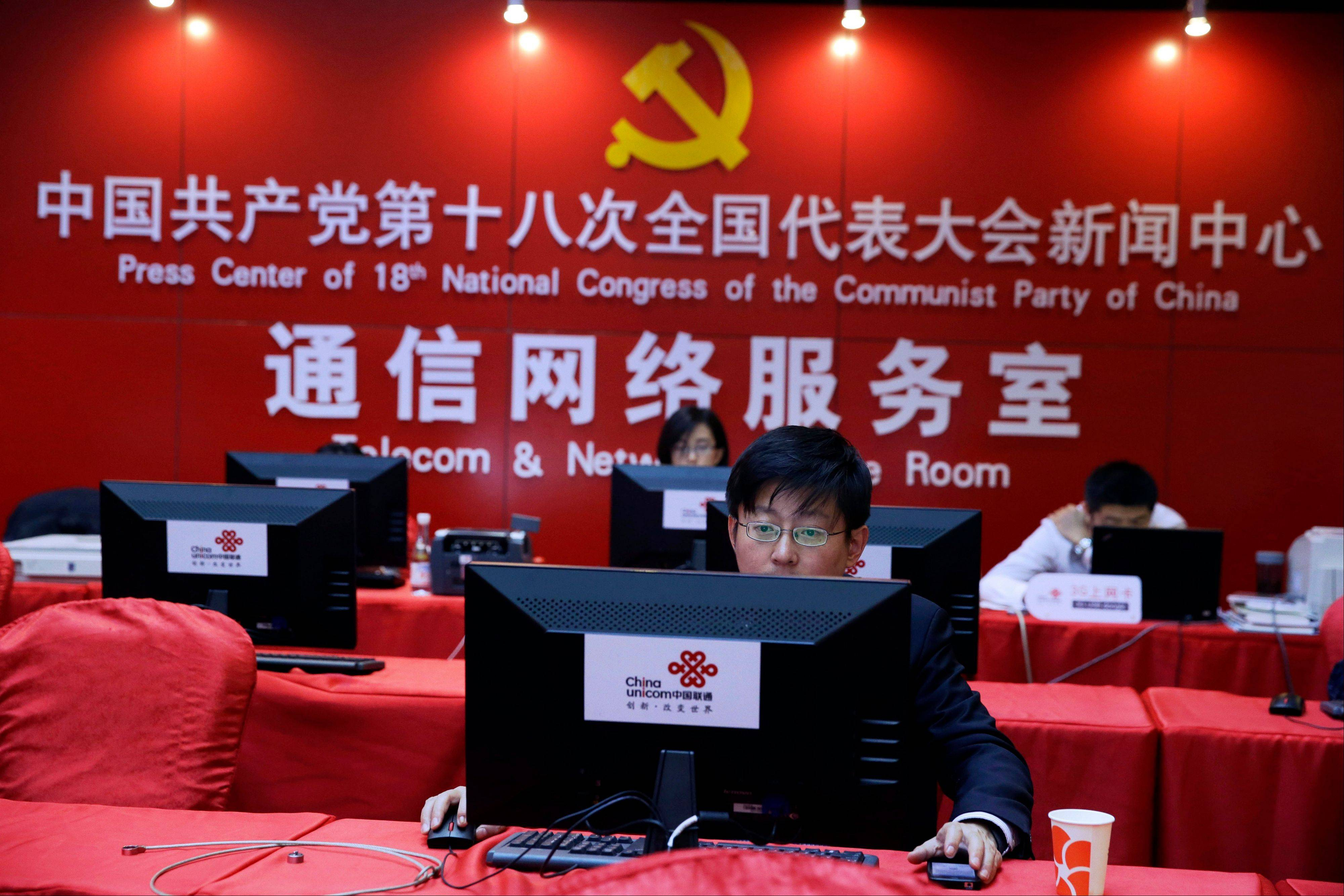 A Chinese man uses a computer Tuesday at the press center of the 18th Communist Party Congress in Beijing. During China's last party congress, the cadres in charge of the world's most populous nation didn't know a hashtag from a hyperlink. But five years later, there's a new message from Beijing: The political transition will be microblogged.