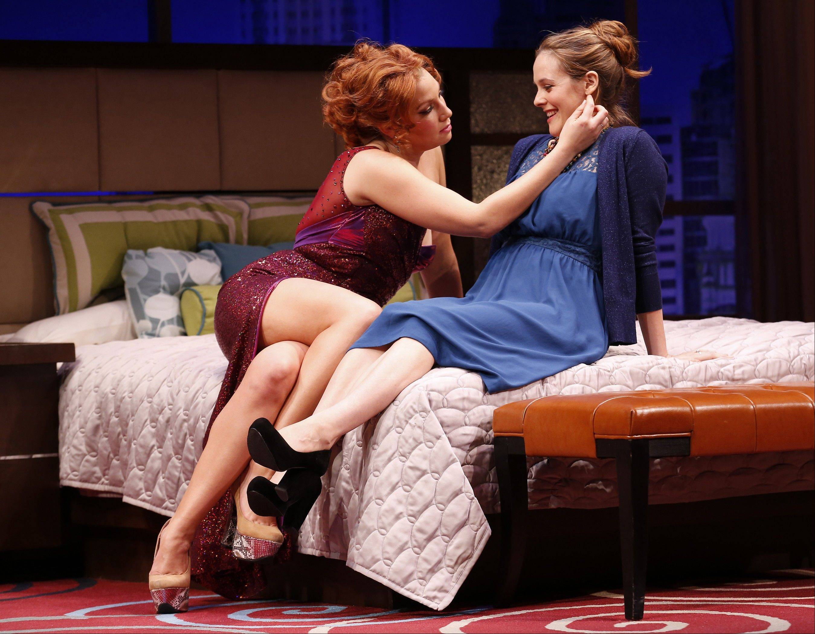 "This theater image released by Sam Rudy Media Relations shows Ari Graynor, left, and Alicia Silverstone during a performance of ""The Performers,"" in New York."