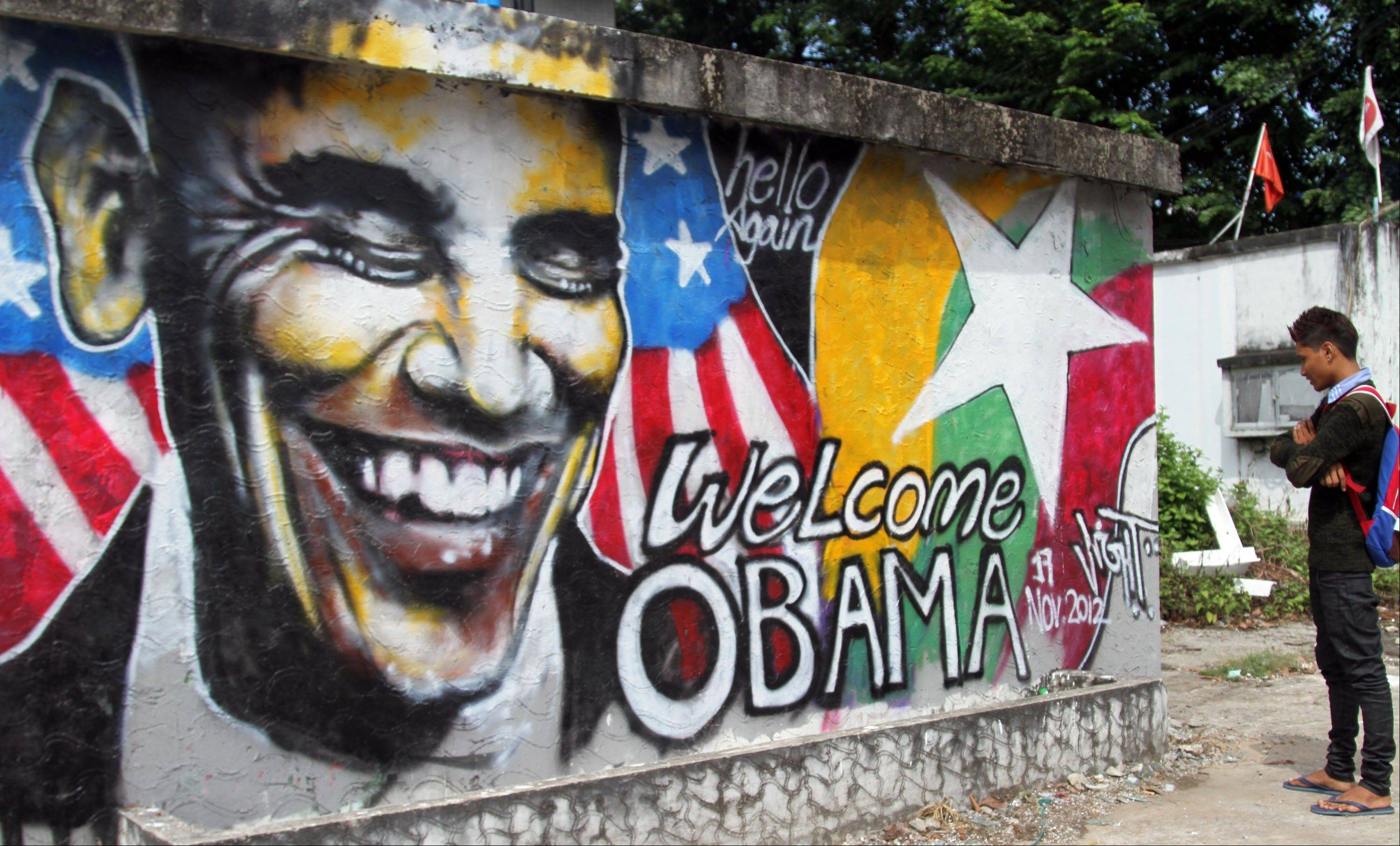 A man looks at a wall painting Saturday created by Myanmar graffiti artists to welcome U.S. President Barack Obama on a street in Yangon, Myanmar.