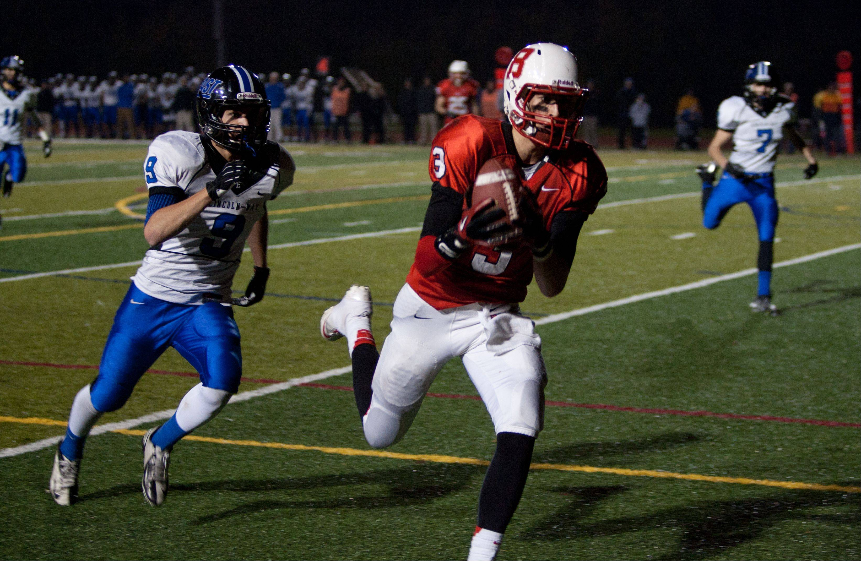 Benet�s Jack Euritt (3), hauls down a fourth down, fourth quarter touchdown pass against Lincoln-Way East.