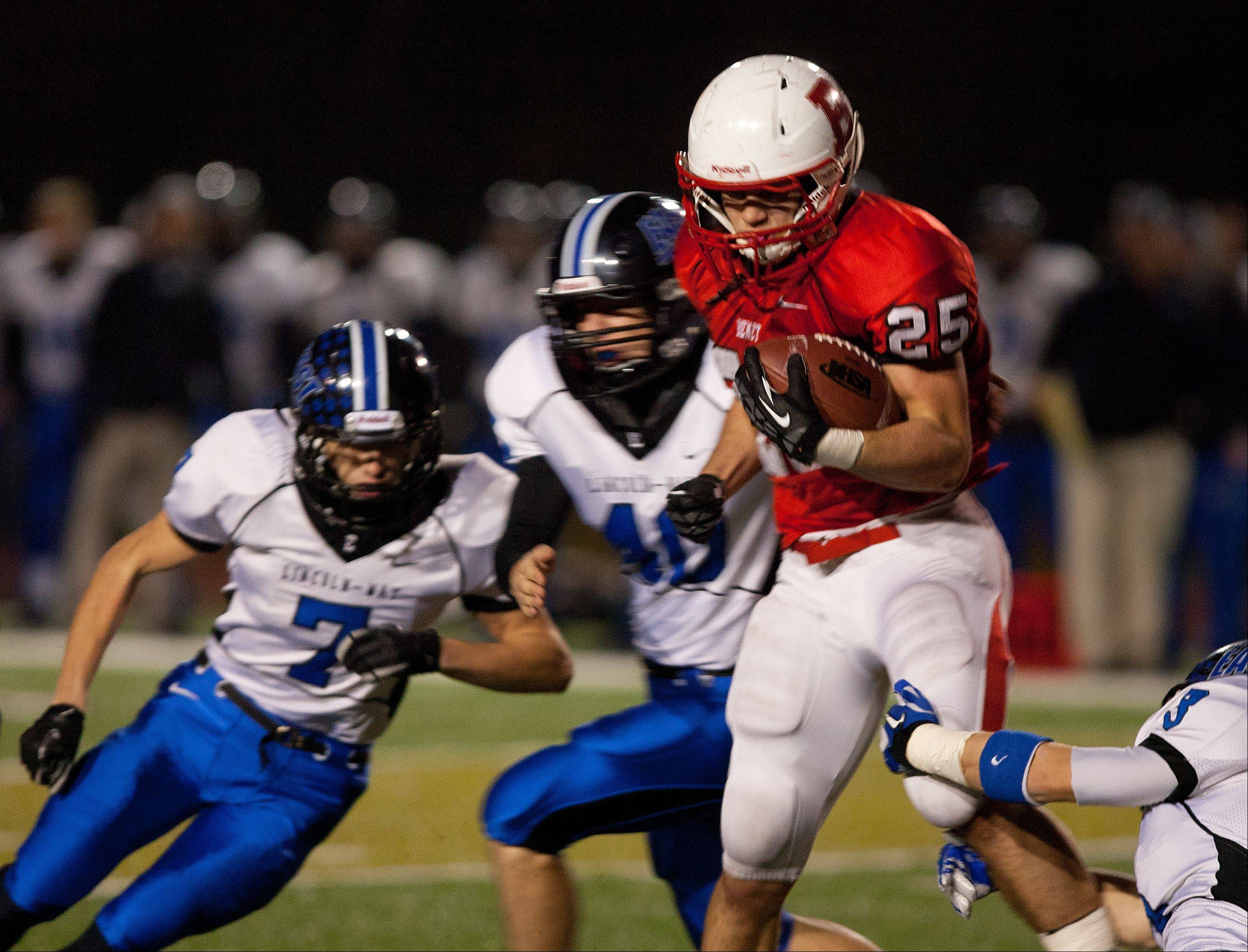 Benet's Porter Ontko (25), looks for first half yardage against Lincoln-Way East during Class 7A football semifinals.