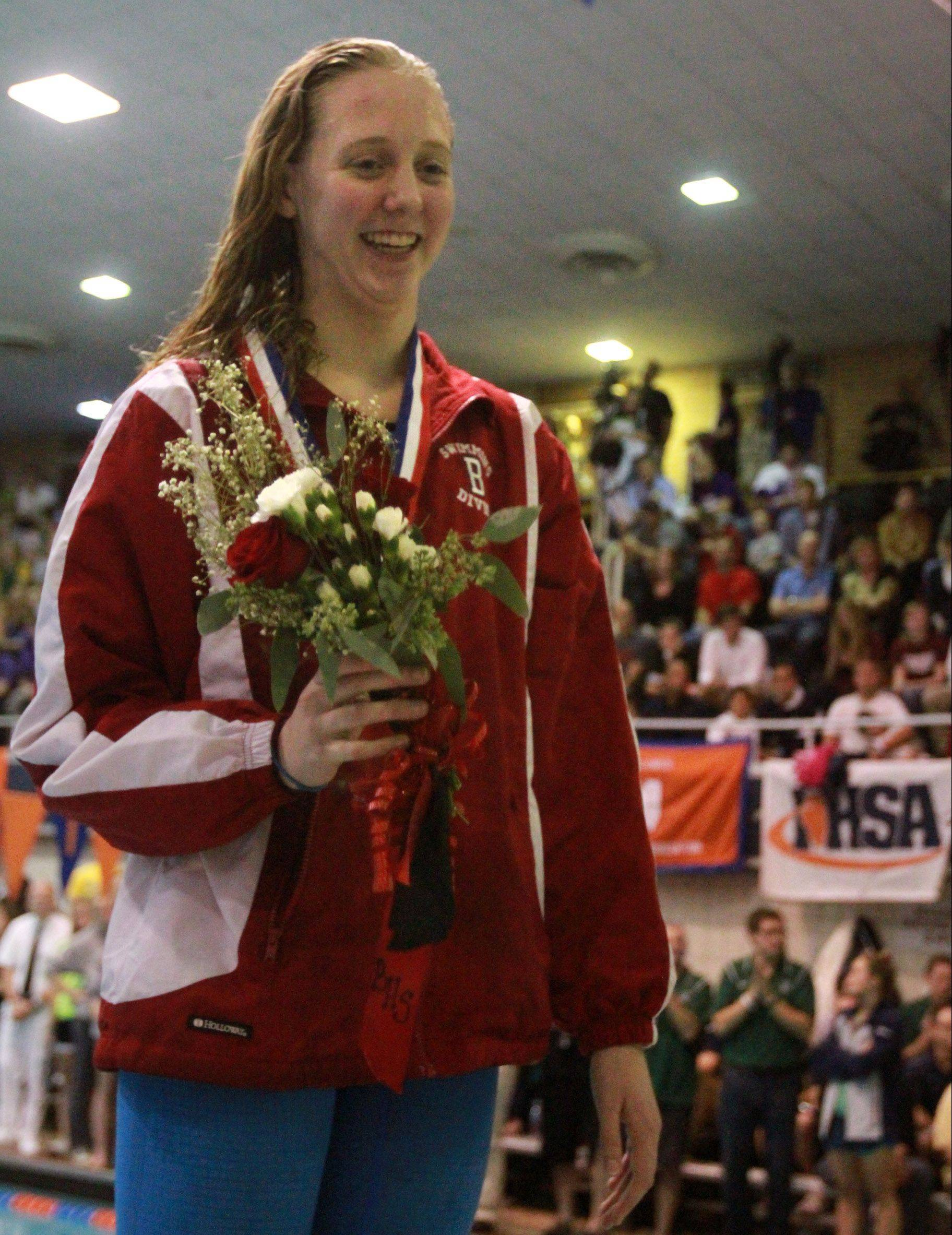 Barrington freshman Kirsten Jacobsen captured the state crown in the grueling 500-yard freestyle and placed third in the 200 freestyle at the IHSA state championships in Evanston on Saturday.