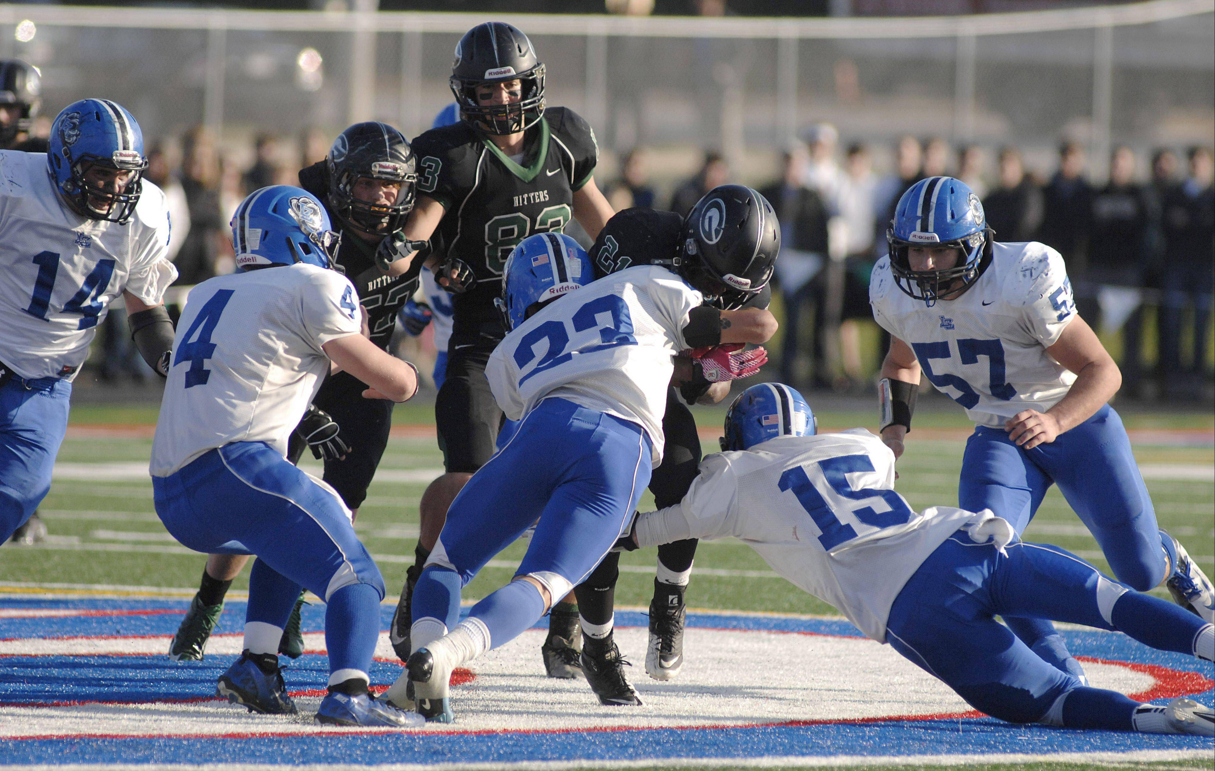 Glenbard West�s Deon Dumas is stopped by Lake Zurich�s Grant Soucy and Matt Moon in the third quarter on Saturday.