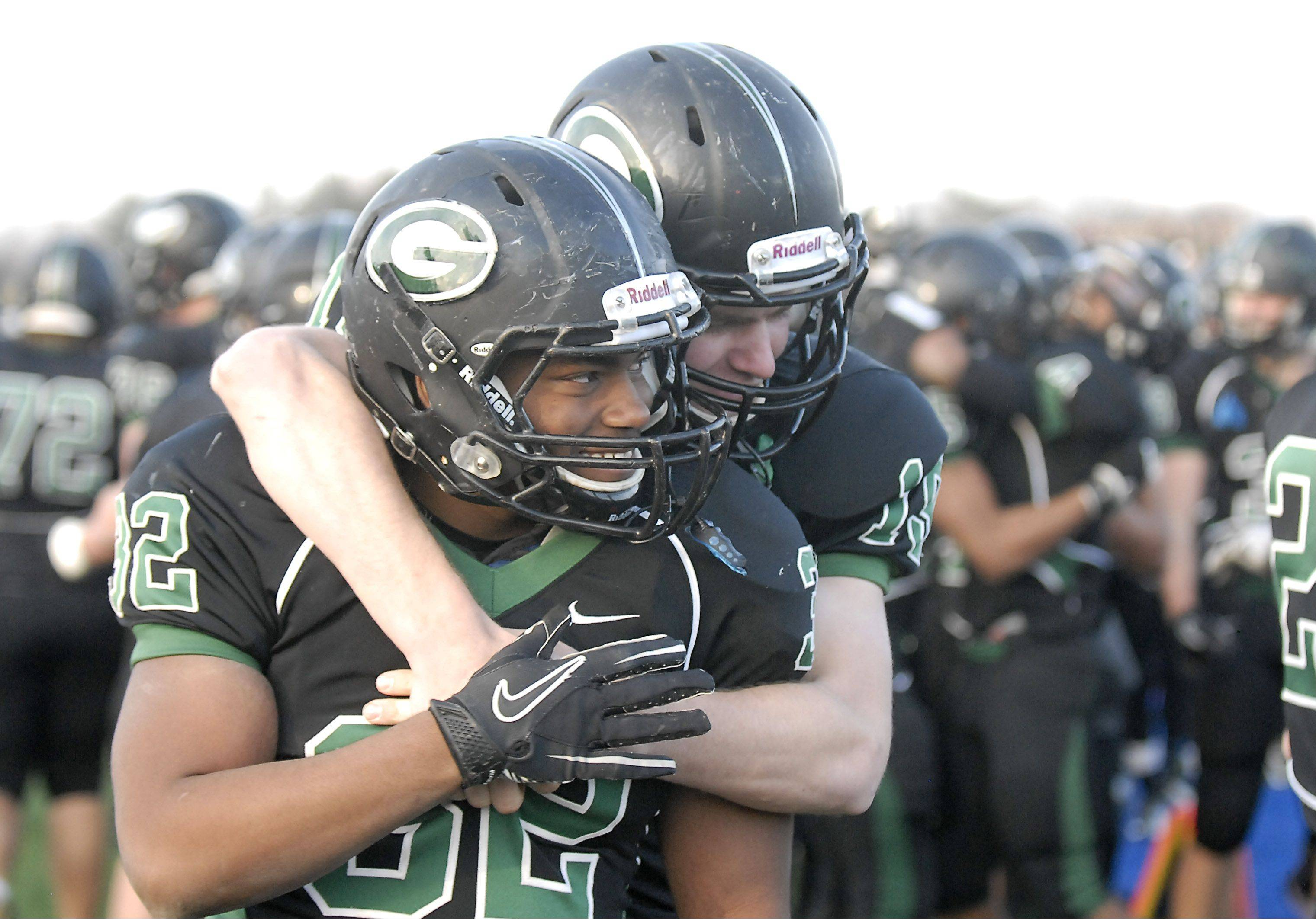 Glenbard West�s Patrick Wilder gets a hug from teammate Hayden Lekacz as the final seconds tick down to their 7A semi-finals victory over Lake Zurich on Saturday, Nov. 17.