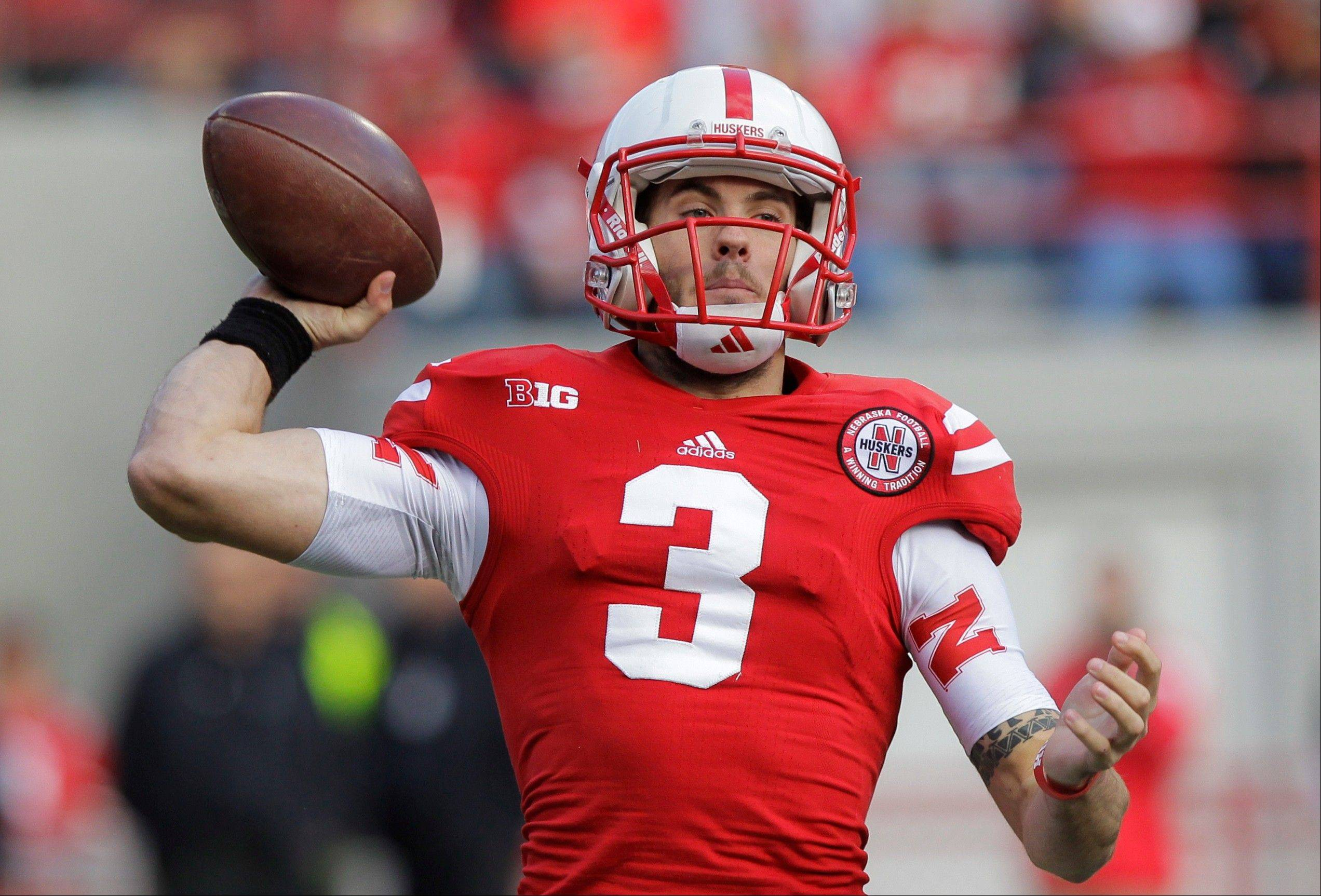 Nebraska quarterback Taylor Martinez throws in the first half of an NCAA college football game against Minnesota in Lincoln, Neb., Saturday, Nov. 17, 2012. (AP Photo/Nati Harnik)