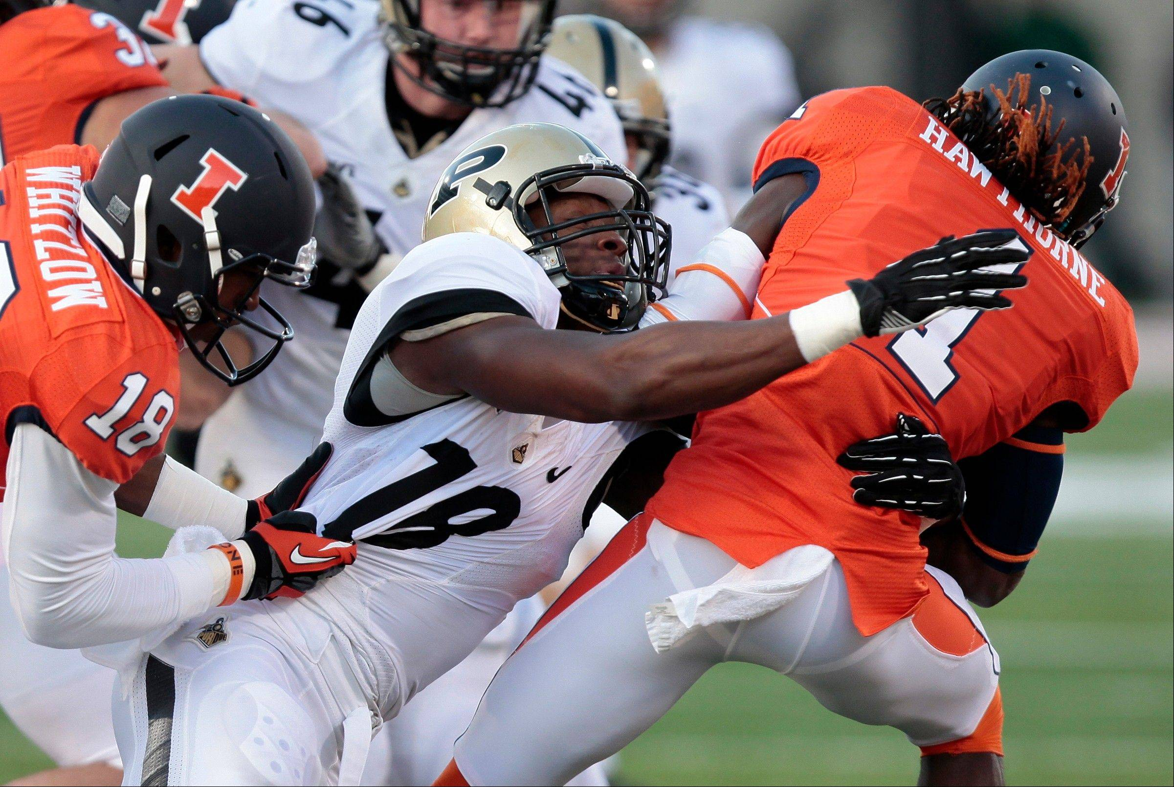 Purdue's Nnamdi Ezenwa (18) tackles Illinois' Terry Hawthorne (1) during the first half of an NCAA college football game on Saturday, Nov. 17, 2012, in Champaign, Ill. (AP Photo/Stephen Haas)
