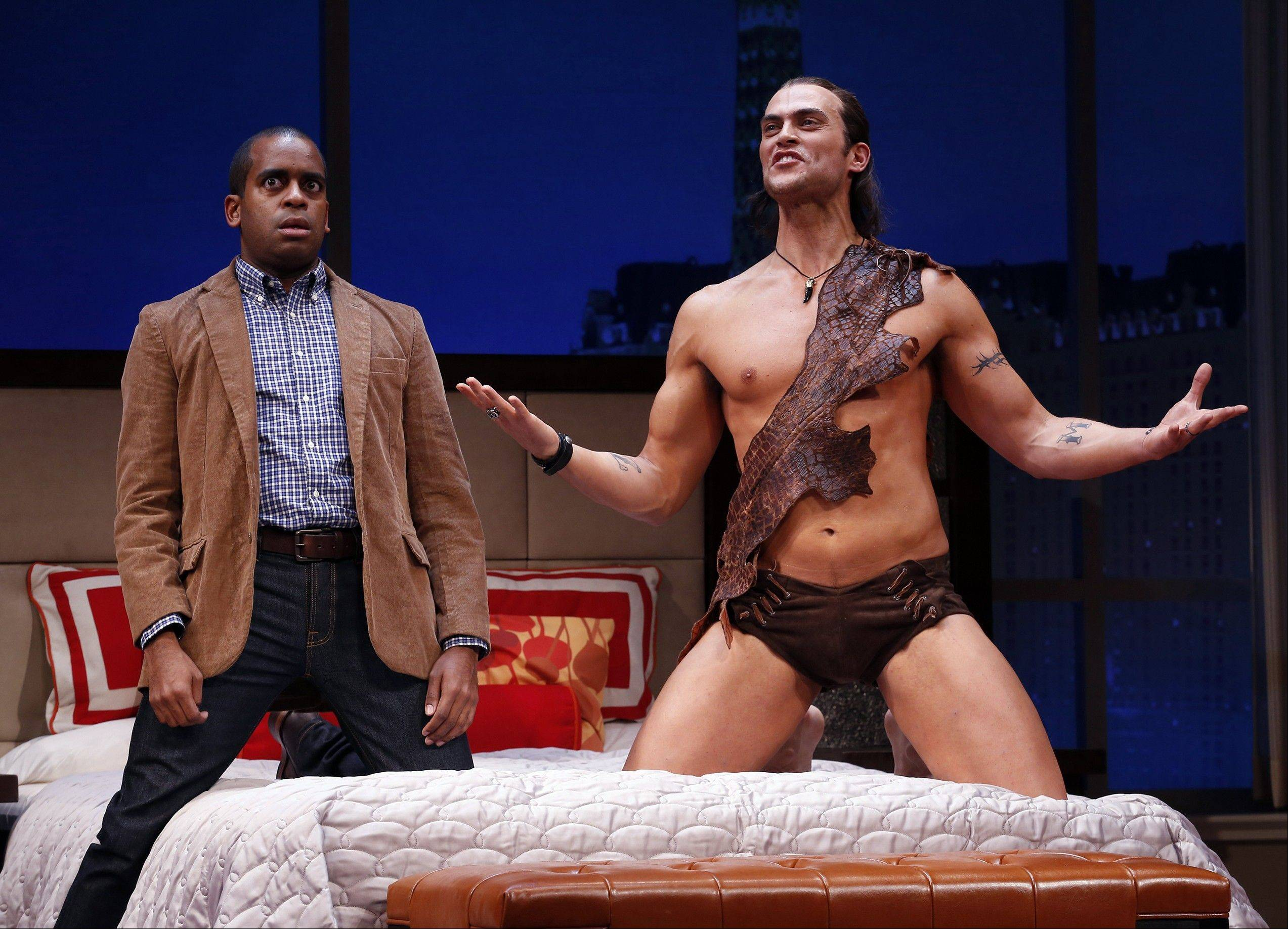 "This theater image released by Sam Rudy Media Relations shows Daniel Breaker, left, and Cheyenne Jackson during a performance of ""The Performers,"" in New York."
