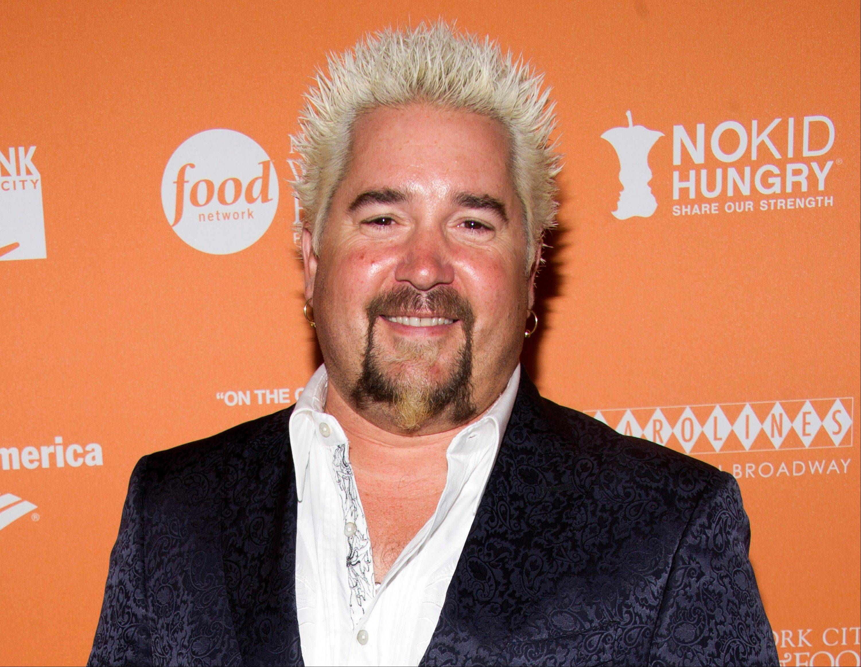 "This Oct. 11, 2012 file photo shows chef Guy Fieri at the ""On The Chopping Block: A Roast of Anthony Bourdain"" in New York."