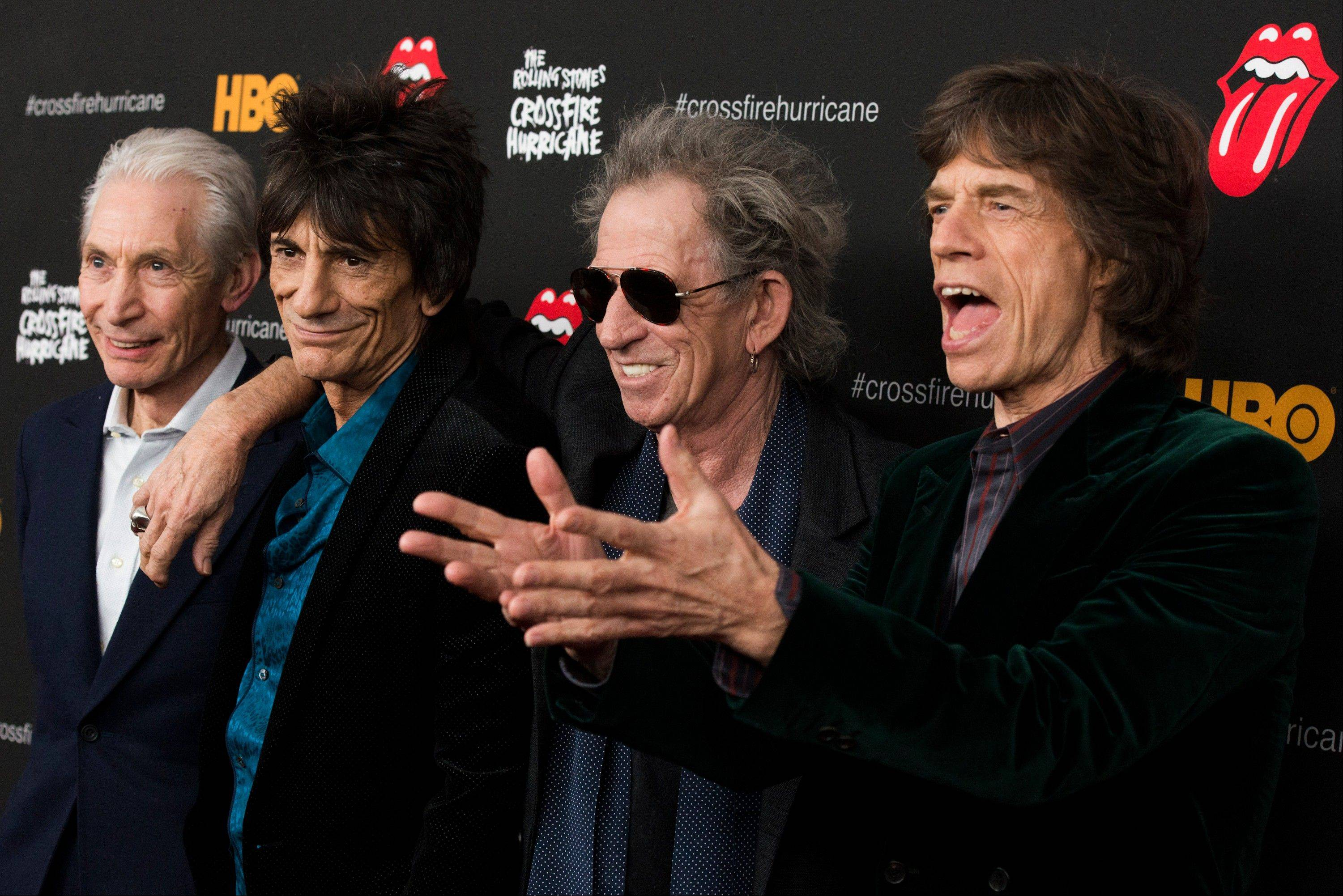 "Rolling Stones band members, from left, Charlie Watts, Ronnie Wood, Keith Richards and Mick Jagger attend ""The Rolling Stones Crossfire Hurricane"" premiere in New York."