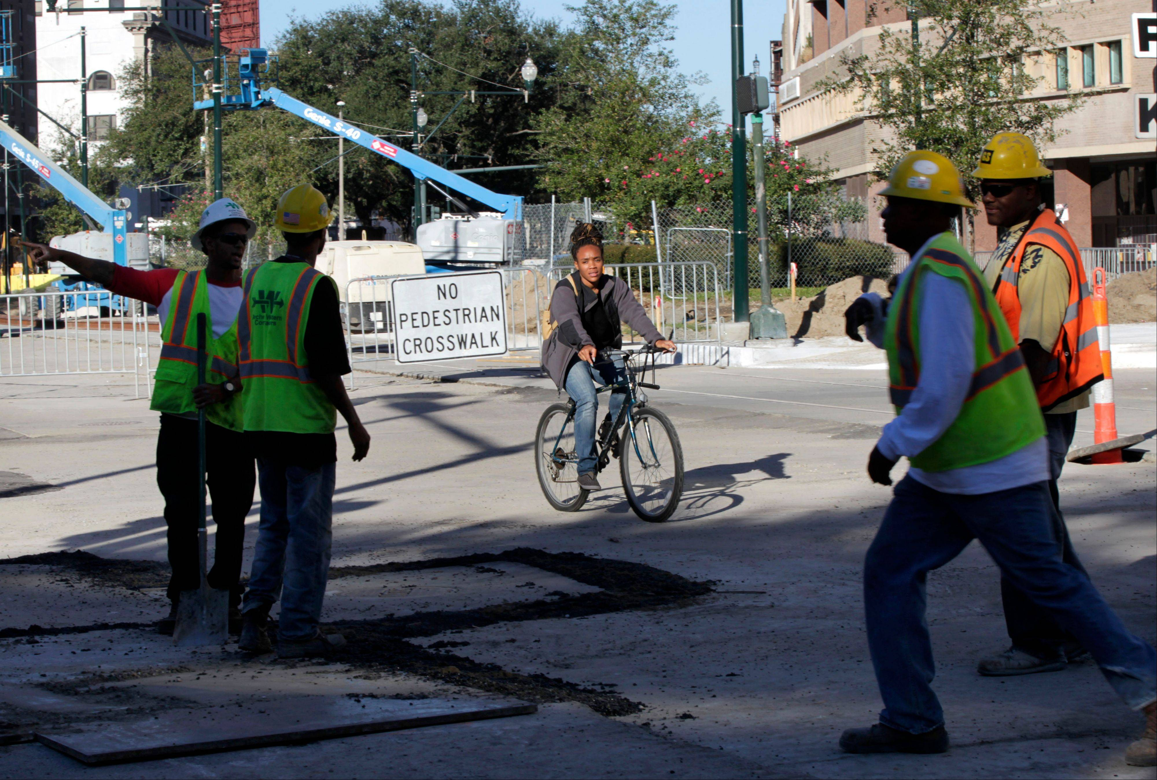 A woman passes by construction on streetcar tracks on Loyola Avenue in New Orleans.