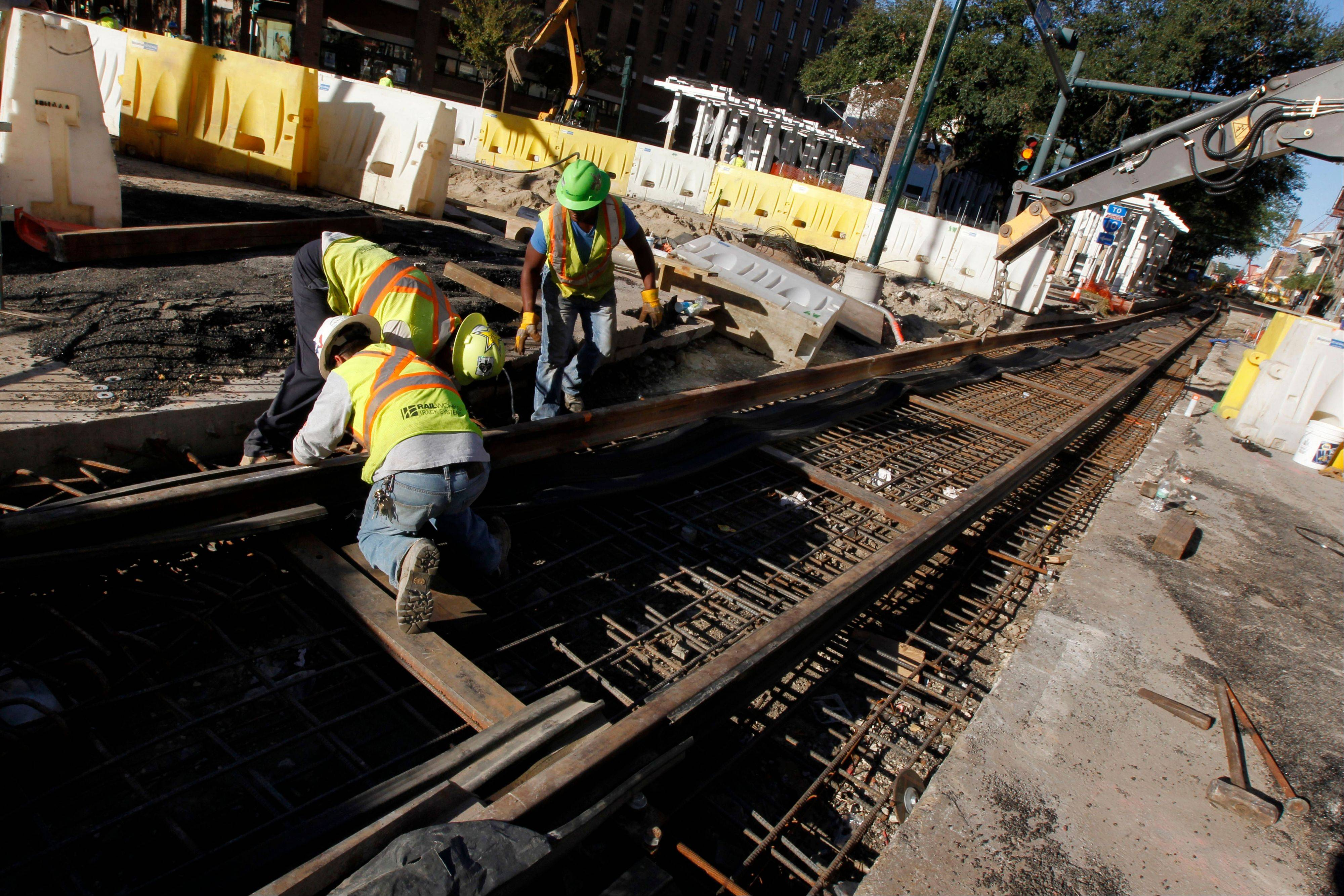 Workers continue work on streetcar track construction in New Orleans.