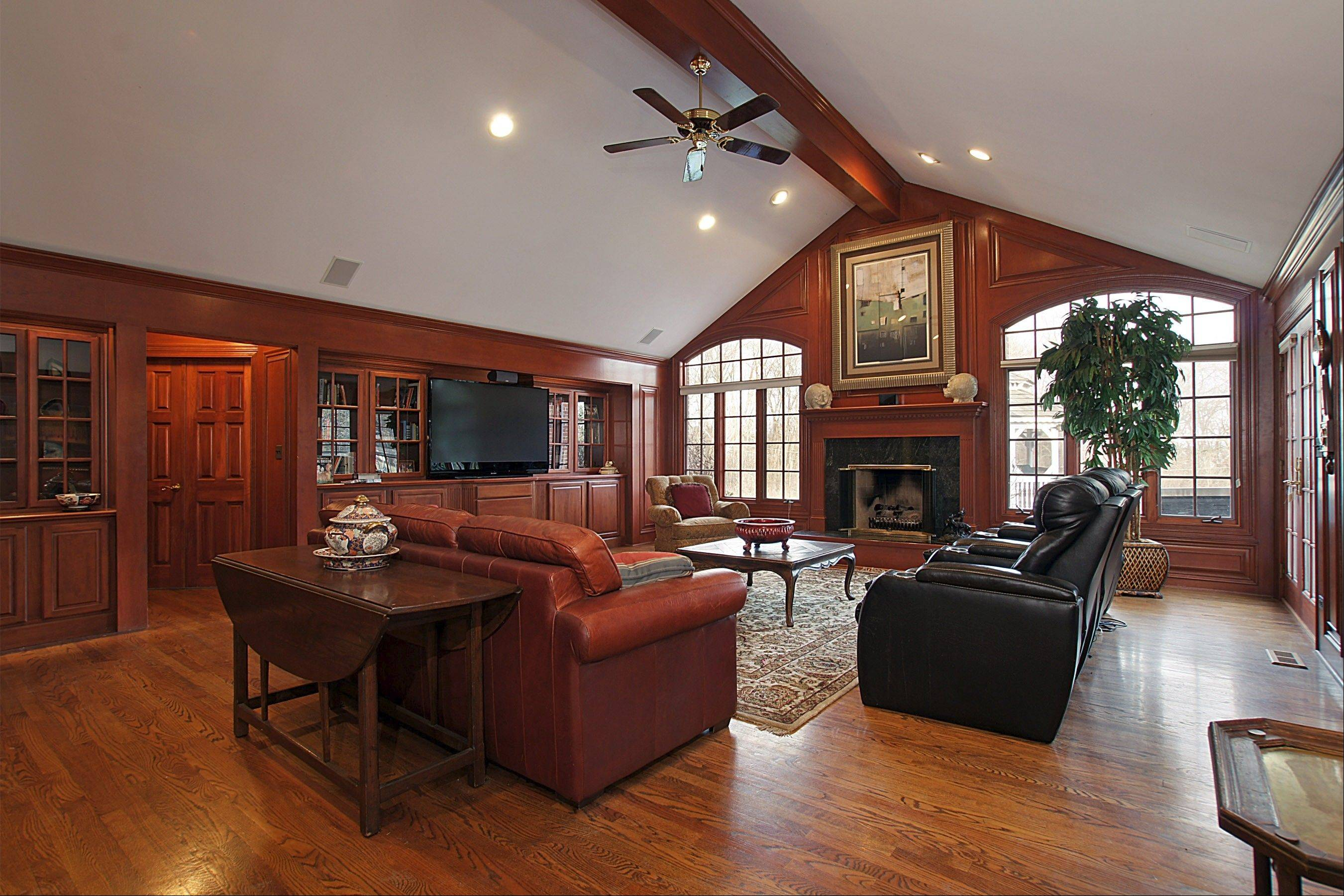 Custom cherry woodwork in the great room leaves a lasting impression.