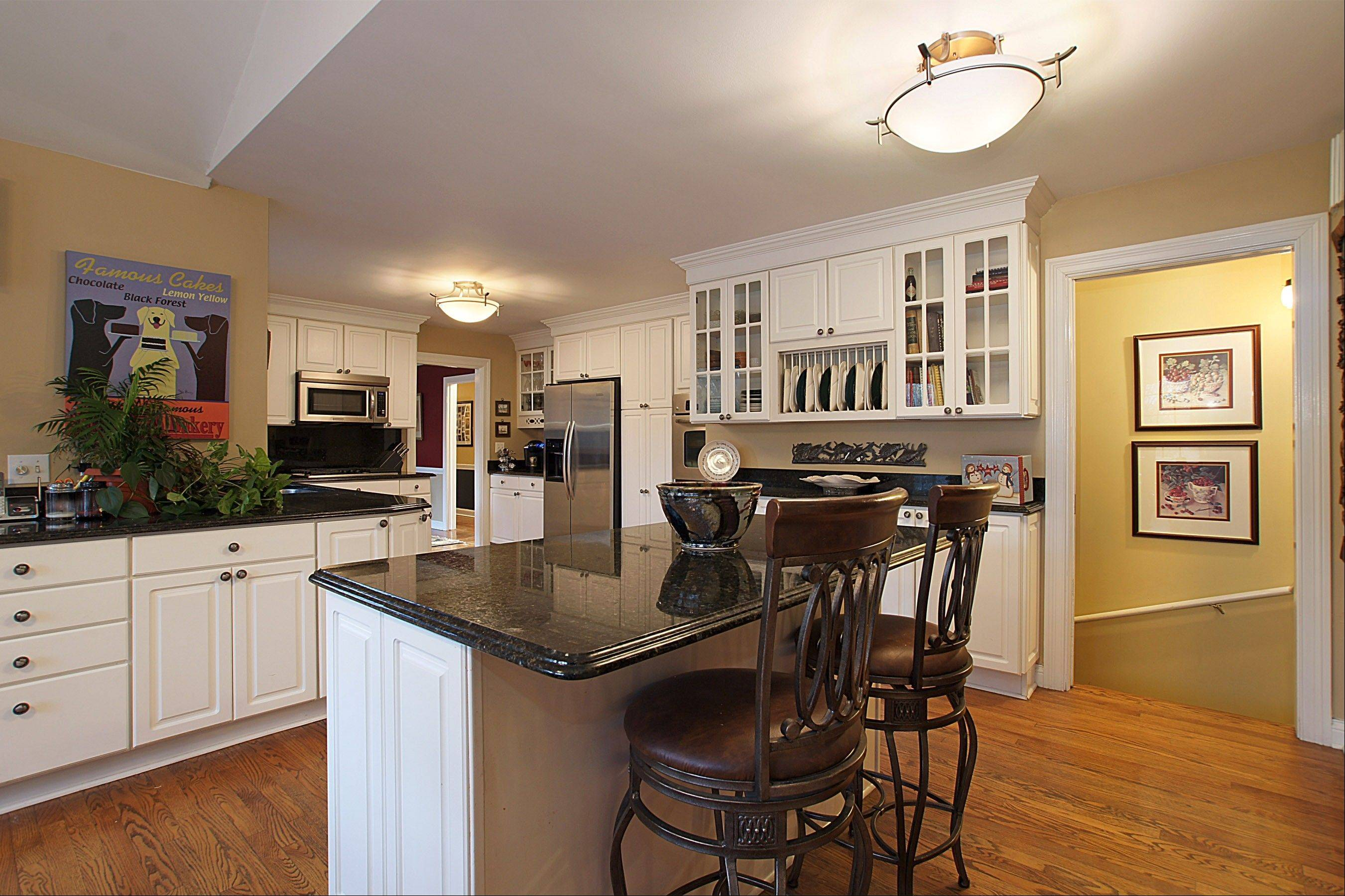 The kitchen has granite countertops and is open to the great room.