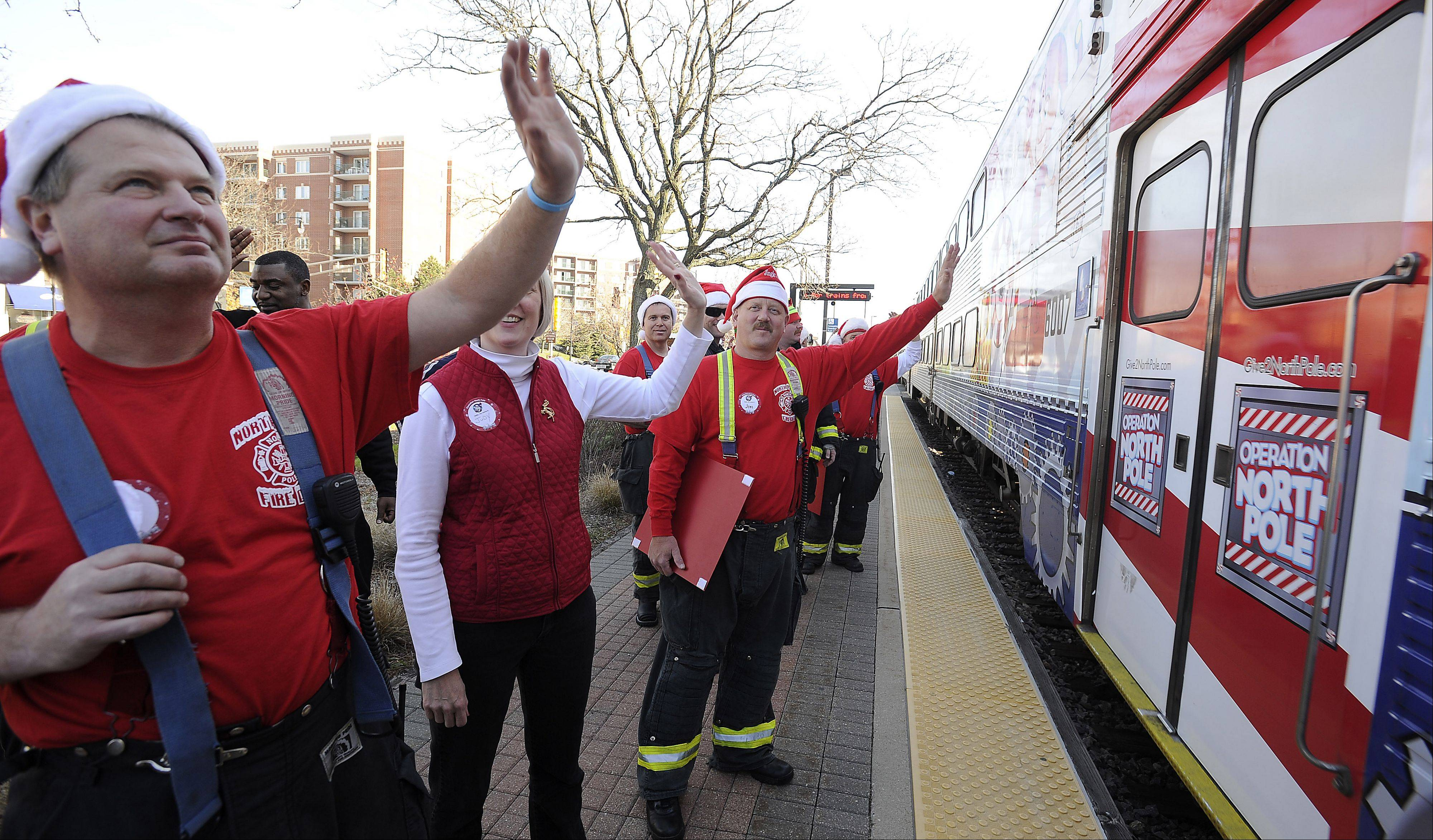 "Des Plaines firefighter Ken Palenik waves to more than 200 children and families who were part of the annual Operation North Pole ""Polar Express"" ride for families who have children with previous or terminal health problems."