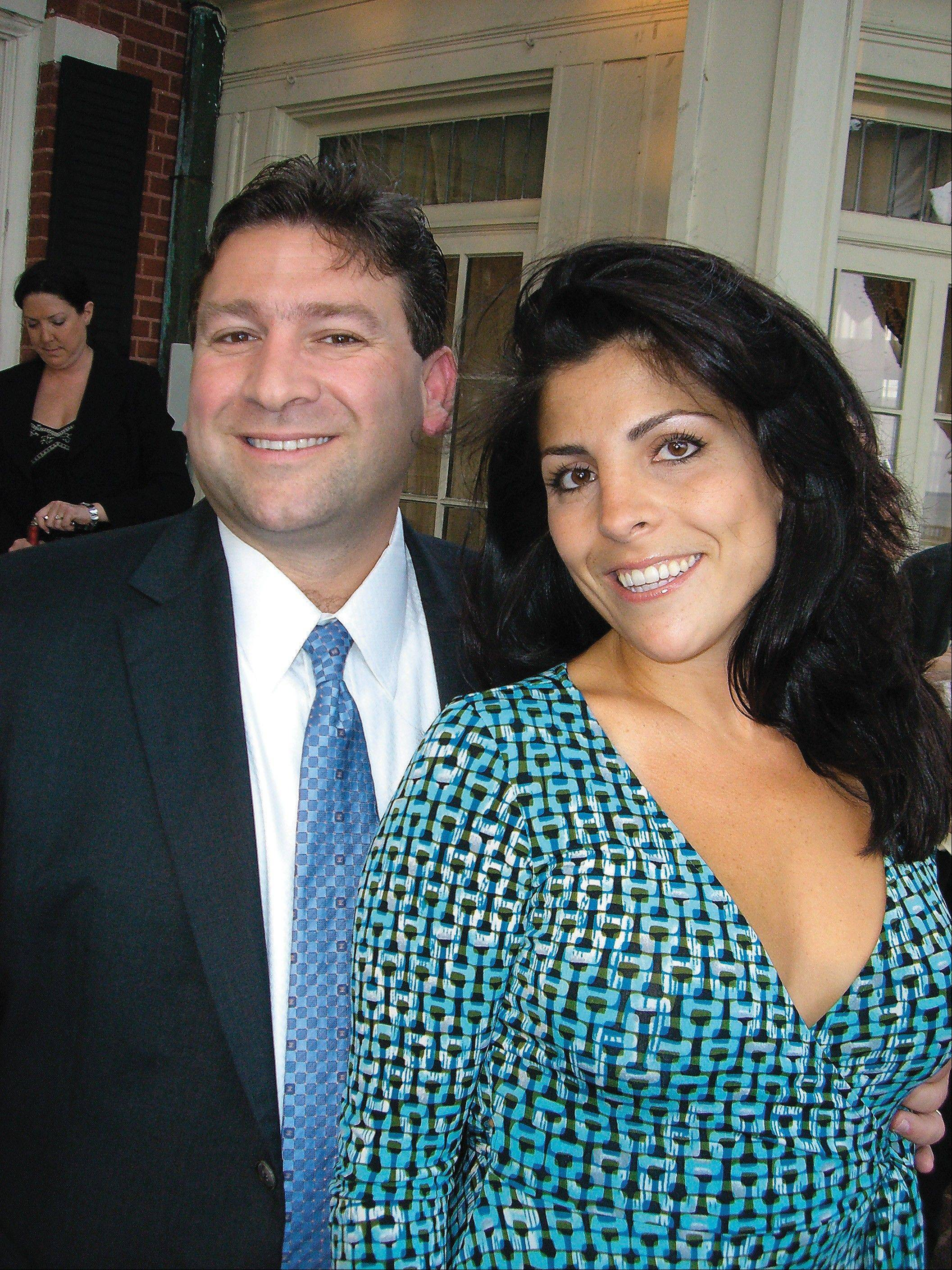 In this March 30, 2007 photo Dr. Scott Kelley, left and his wife Jill Kelley pose for a photo in Tampa, Fla.