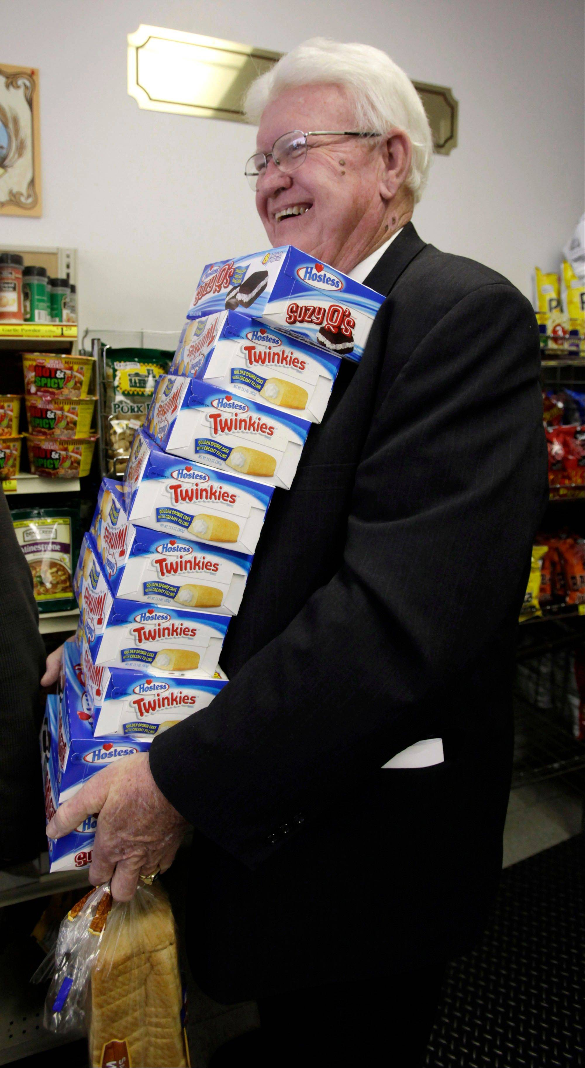 Curtis Smout stands in line with a stack of Twinkies at the Hostess Thrift Shop in Ogden, Utah on Friday.