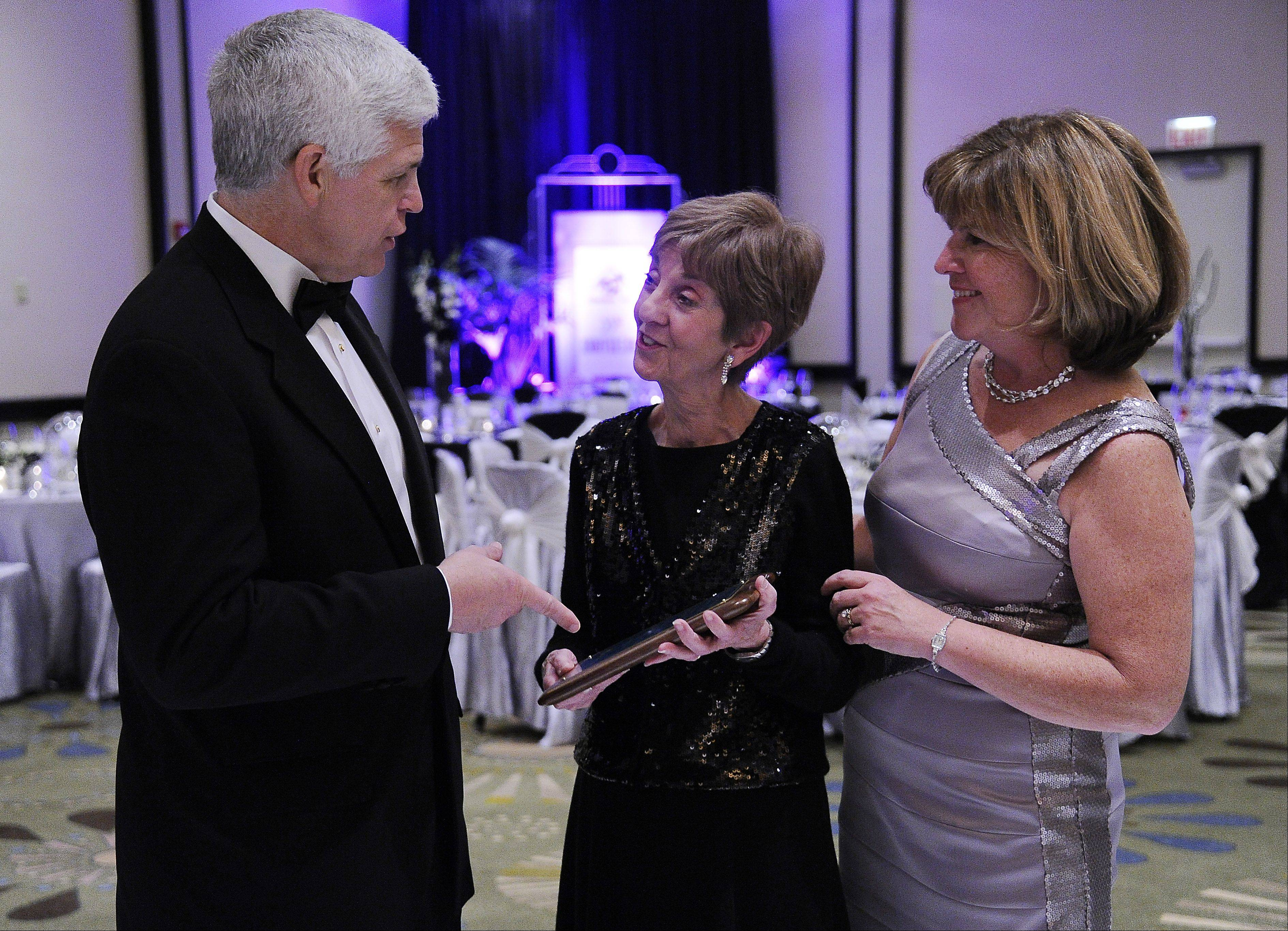 Pat Beck, center, executive director of Shelter Inc., presents the Paul Buckholz Award to Michael and Margaret Tower of Glenview on Friday at the 25th anniversary Charity Ball at the Hyatt in Schaumburg.