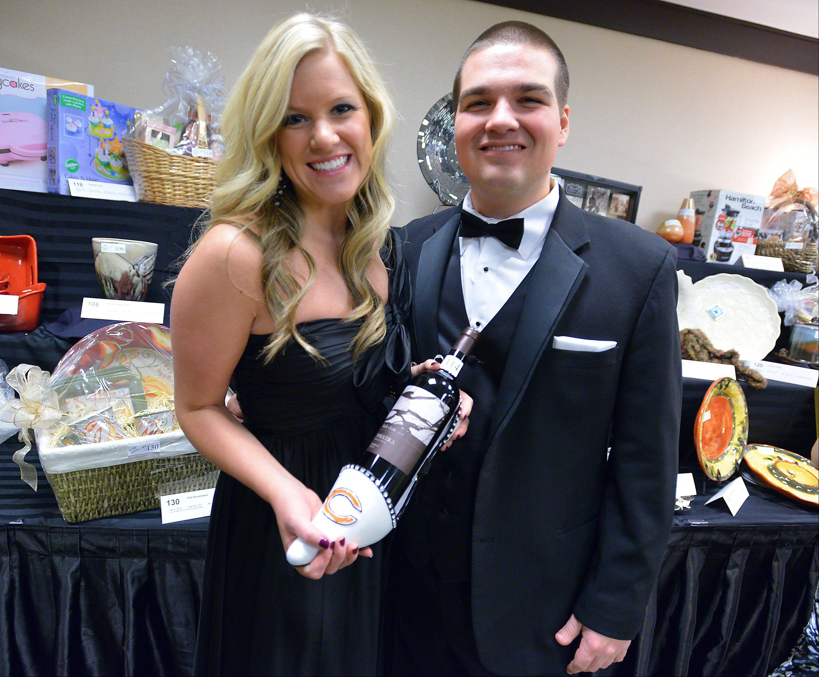Meghan O' Kelly and Kevin Sporleder of Chicago check out the items for auction Friday at Shelter Inc.'s 25th anniversary Charity Ball at the Schaumburg Hyatt.