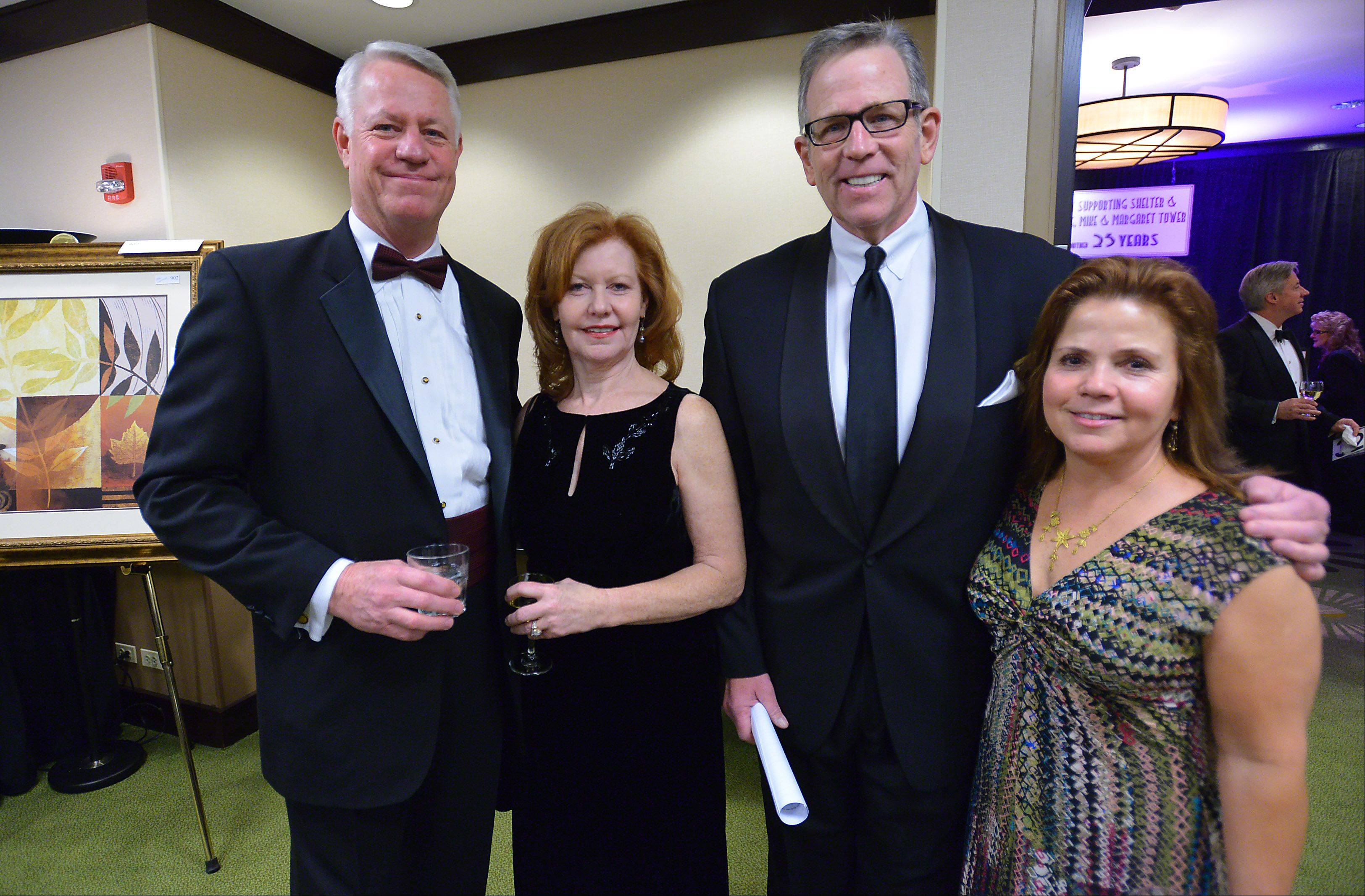 Jeff and Gloria Heck of Antioch, left, stand with Dick Johnson of NBC and Jan Golden of Arlington Heights at Friday's 25th anniversary Charity Ball for Shelter Inc. at the Schaumburg Hyatt.
