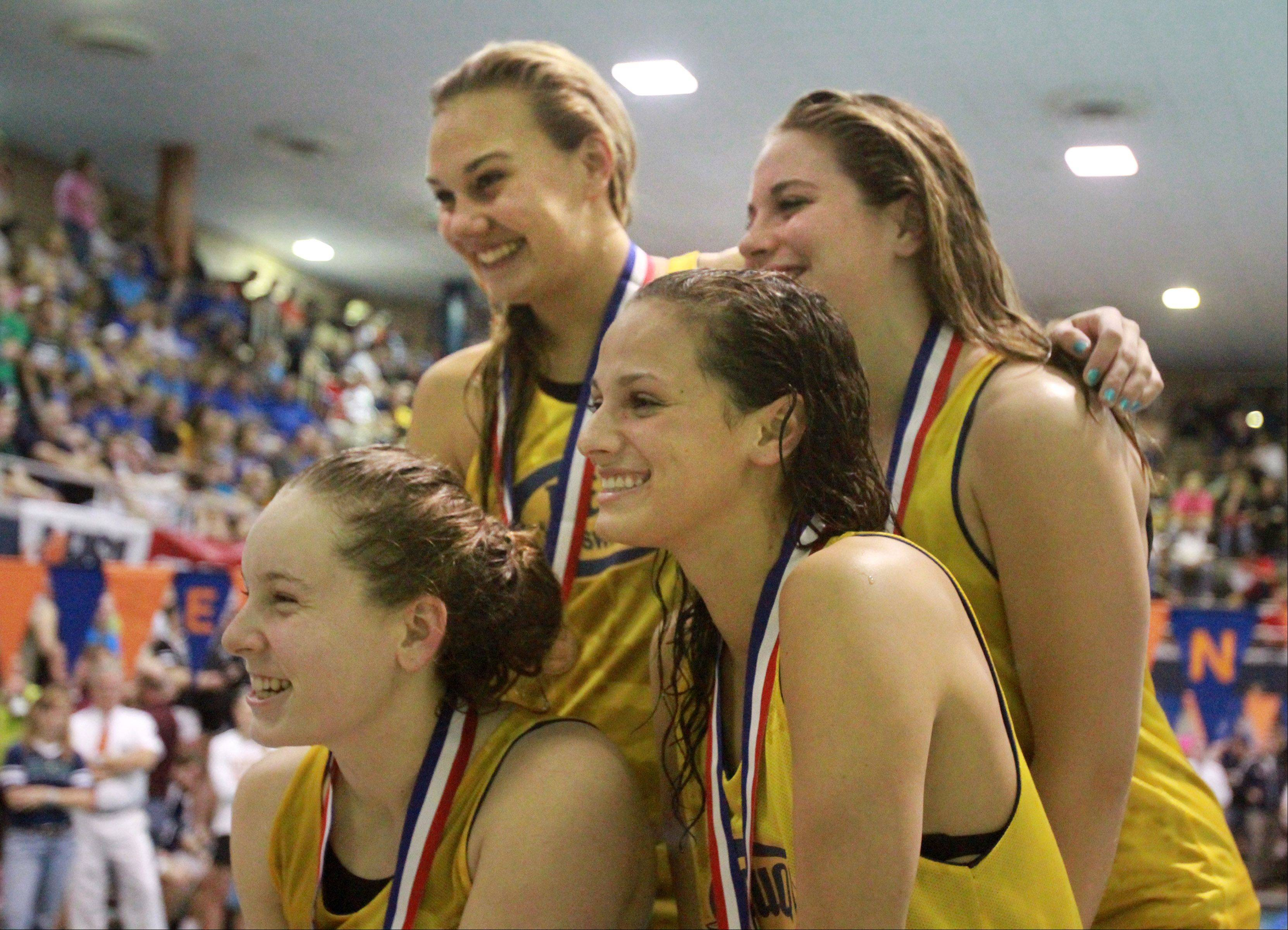 Nequa Valley's Natalie McGovern, Megan Childs, Gia Dalesandro, and Riley Schroedter tied for third place in the 200-yard medley relay at the IHSA state championships in Evanston on Saturday.