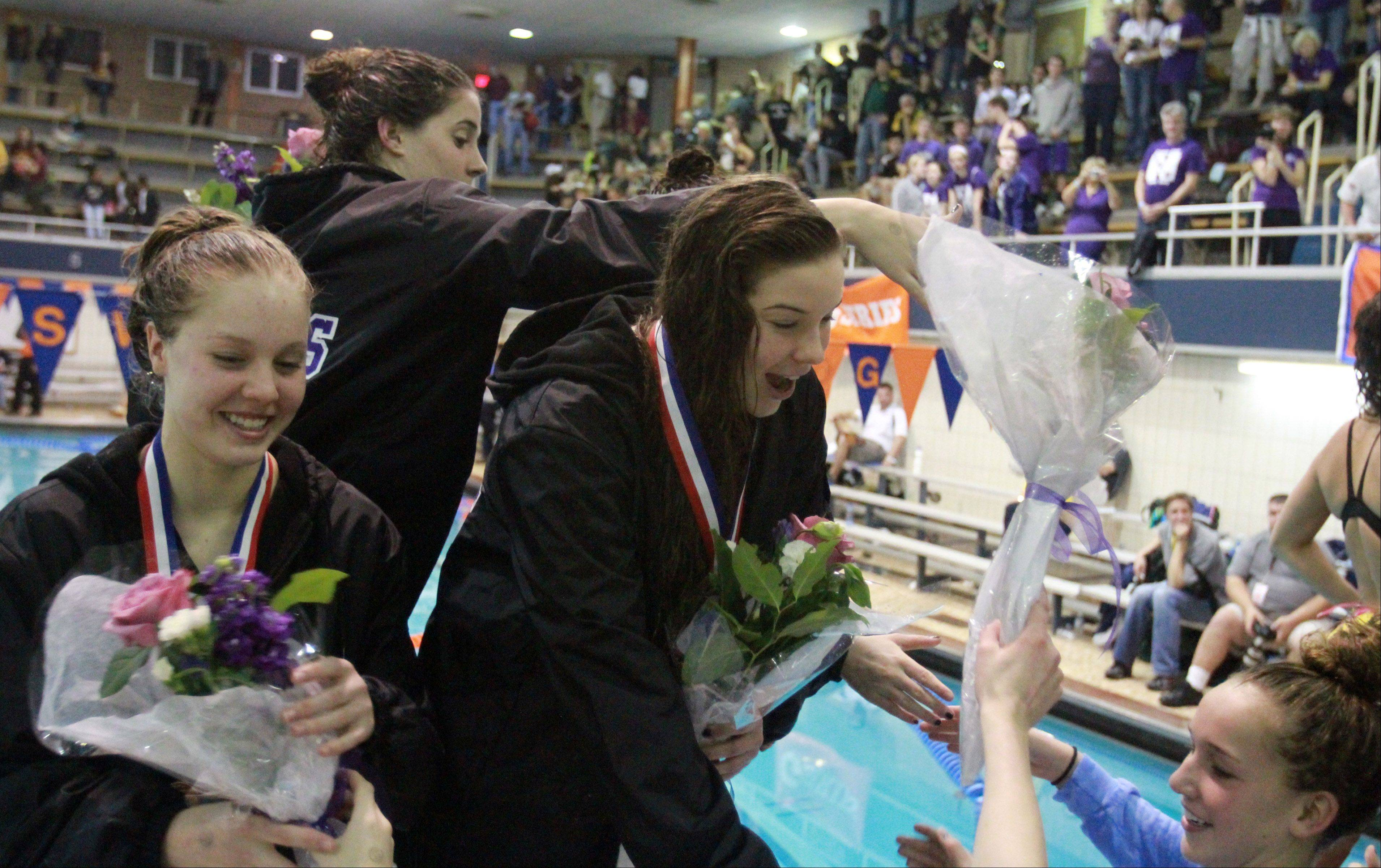 Downers Grove's Maddy Sims, Emily Albrecht, Hannah Kaufmann, and Gabby Sims placed fourth in the 400-yard freestyle relay at the IHSA state championships in Evanston on Saturday.