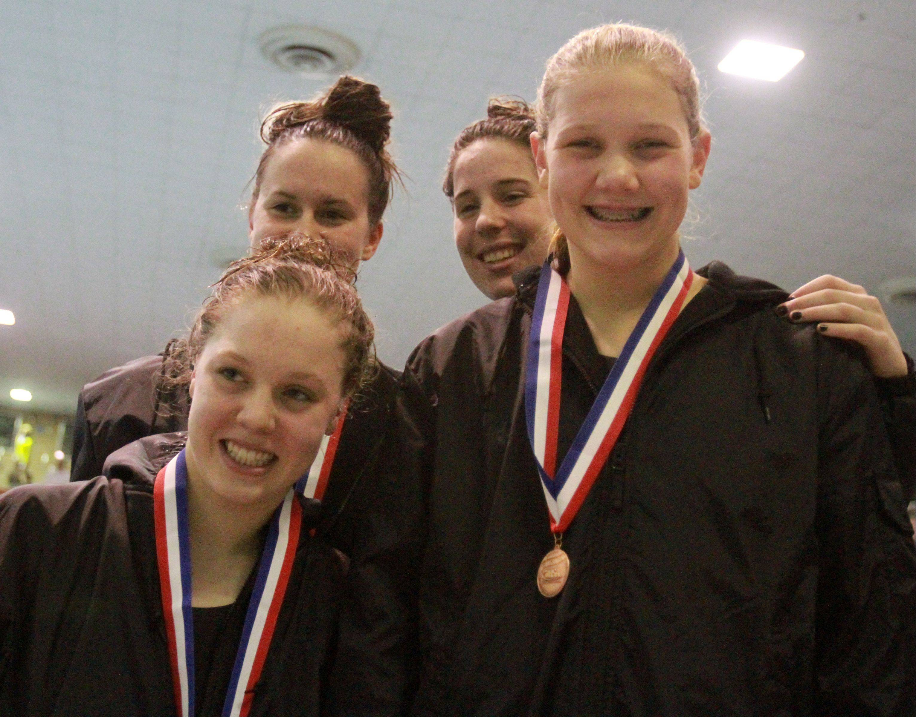Downers Grove North's Gabby Sims, Gabriele Serniute, Daria Wick, and Emily Albrecht placed fifth in the 200-yard medley relay at the IHSA state championships in Evanston on Saturday.