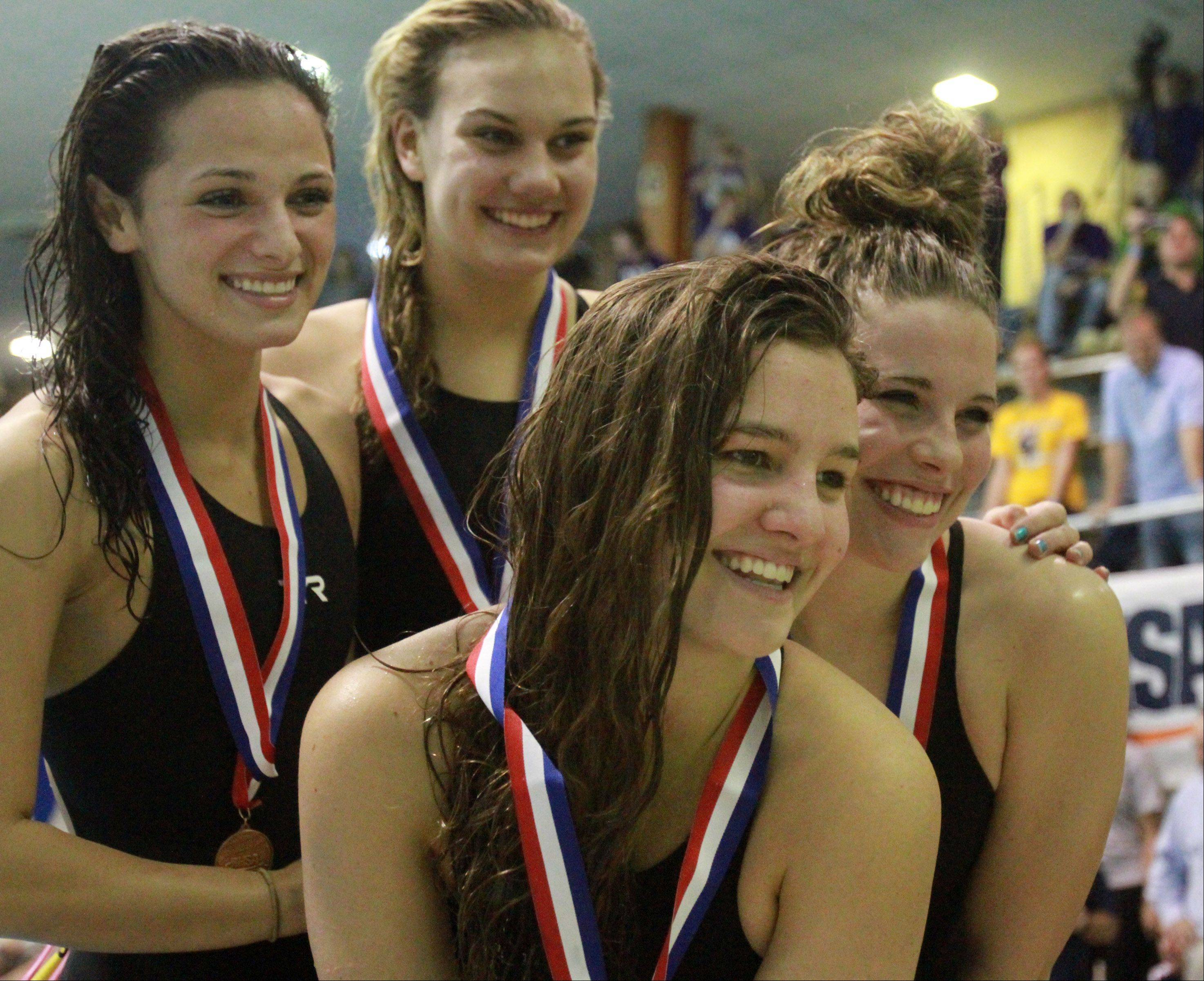 Neuqua Valley's Riley Schroedter, Megan Childs, Grace Soltys, and Gia Sims placed fifth in the 400-yard freestyle relay at the IHSA state championships in Evanston on Saturday.