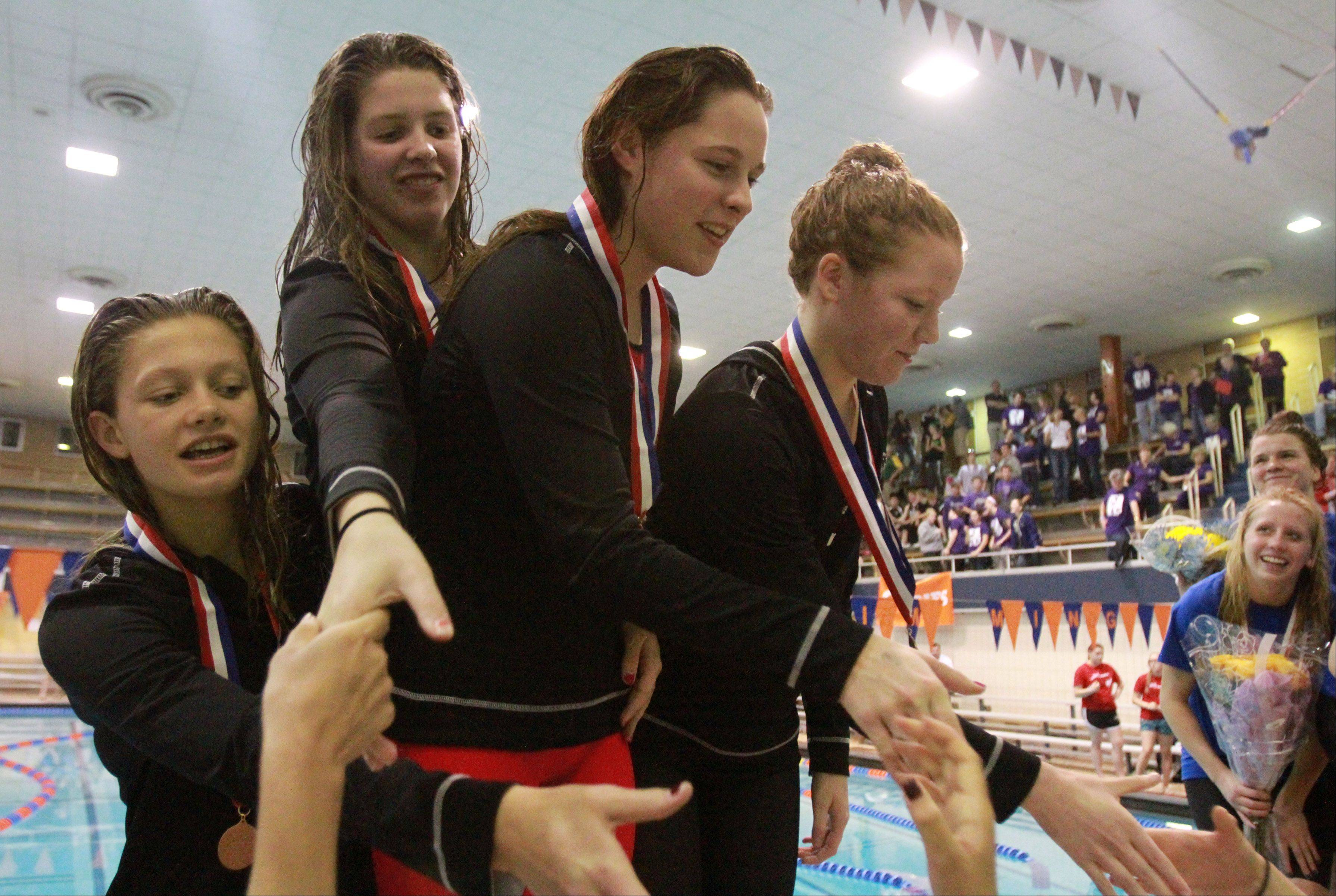 Mundelein's Erin Falconer, Jennifer Kordik, Rachel Robb, and Karrie Kozokar placed eight in the 400-yard freestyle relay at the IHSA state championships in Evanston on Saturday.
