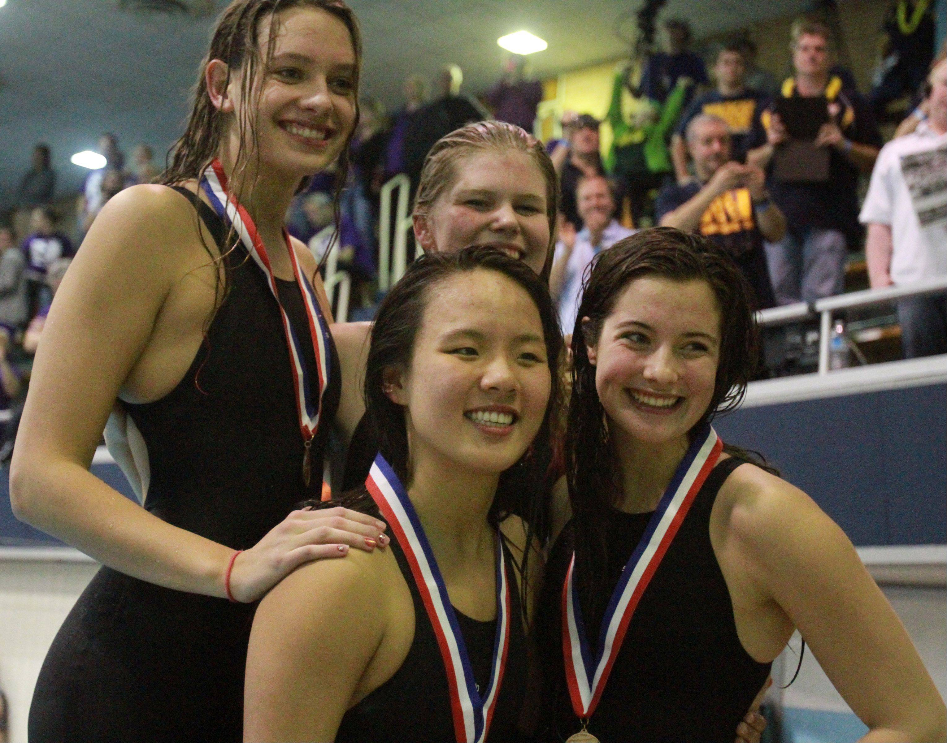 Stevenson's Cheryl Xiang, Madison Blaydes, Riley Kirby, and Julia Wawer placed sixth in the 400-yard freestyle relay at the IHSA state championships in Evanston on Saturday.