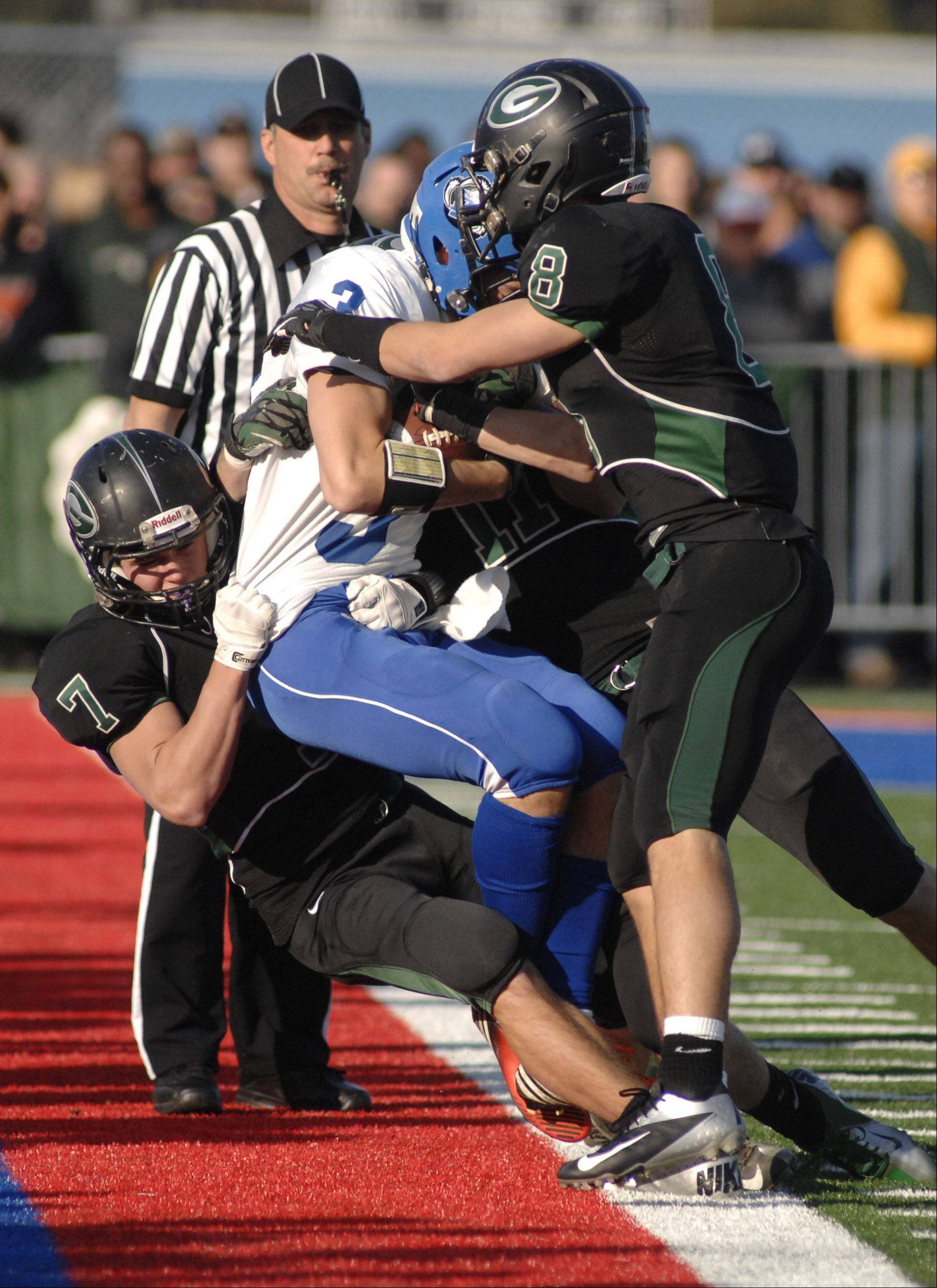 Glenbard West's Charlie Sweeney (7) gets help from Hayden Carlson (8) to knock down Lake Zurich's Steven Walcott in the second quarter on Saturday, Nov. 17.