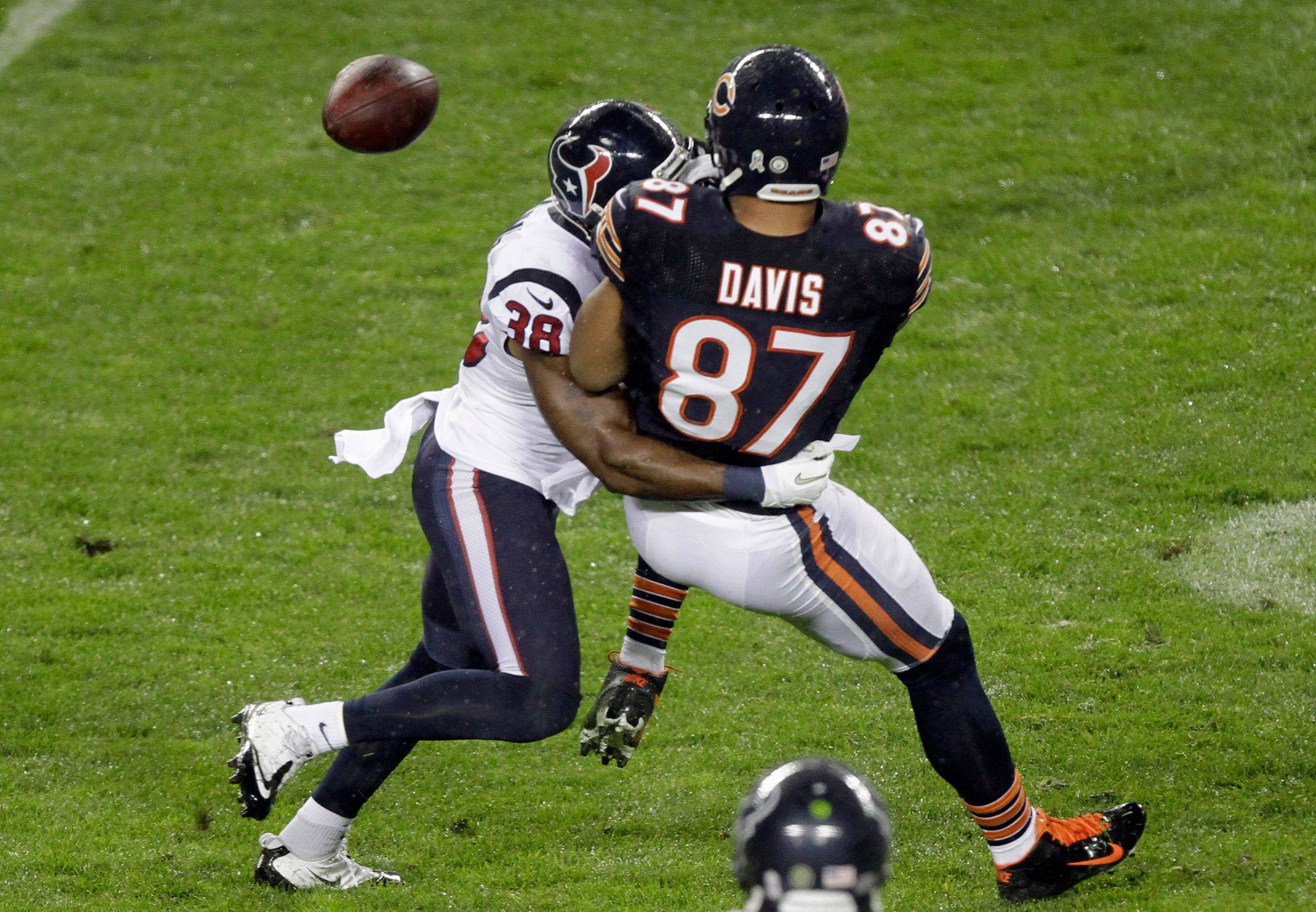 Kellen Davis fumbles as he is crunched by Texans safety Danieal Manning on the first play of last week's Bears loss at Soldier Field.