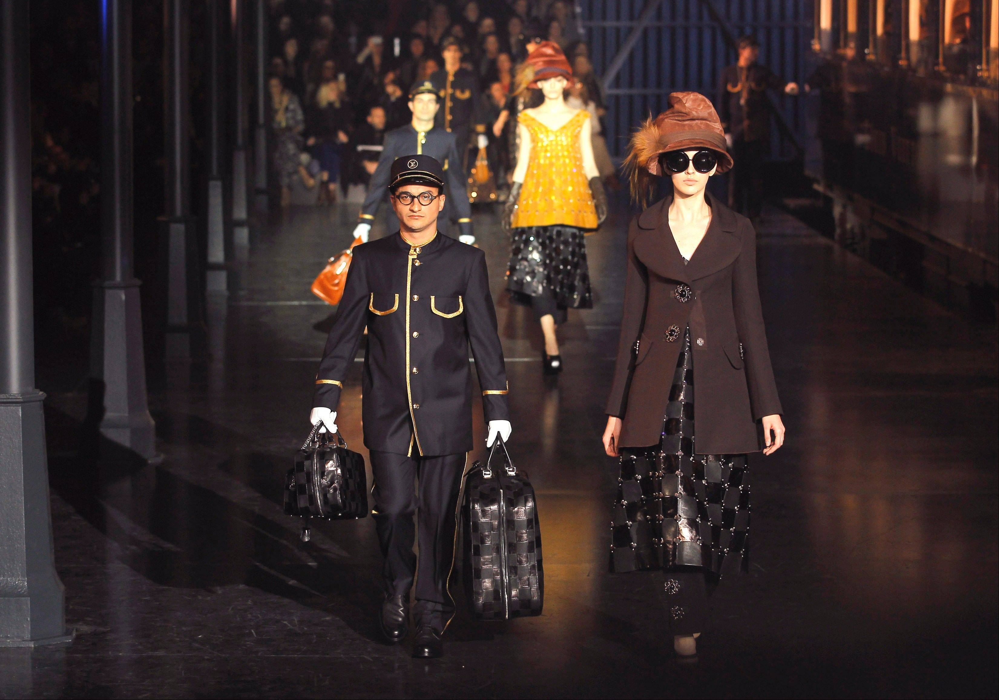 A model wears a creation by U.S fashion designer Marc Jacobs for his Louis Vuitton collection, Women's Fall-Winter, ready-to-wear 2013 during Paris Fashion week. Polished sophistication is the new trend after previous trends that have alternately favored bohemian, aggressive and blingy looks.