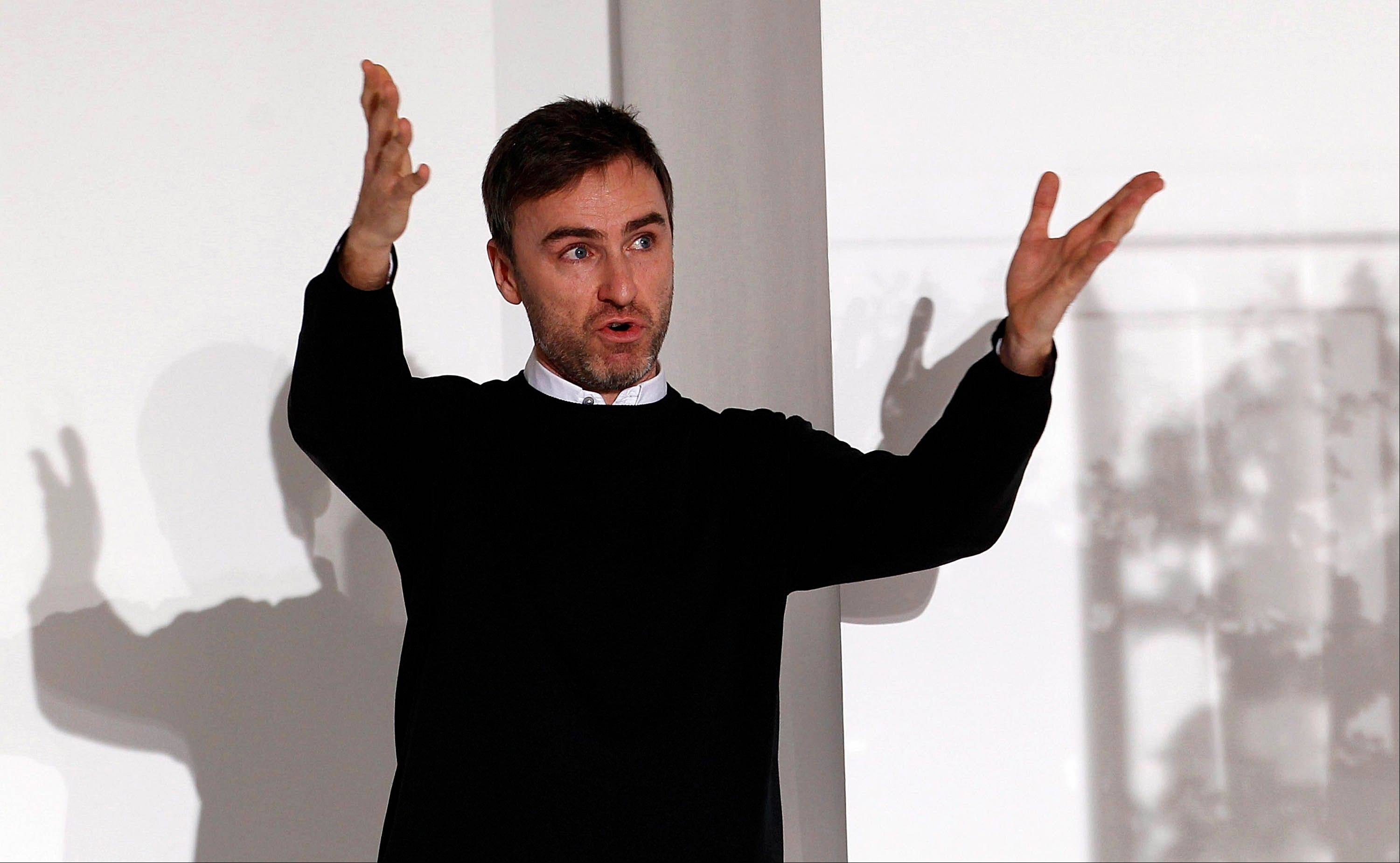 This Sept. 25, 2011 file photo shows Belgian designer Raf Simons at the end of the Jil Sander Spring/Summer 2012 women's collection in Milan. Simons is the Creative Director at Christian Dior.