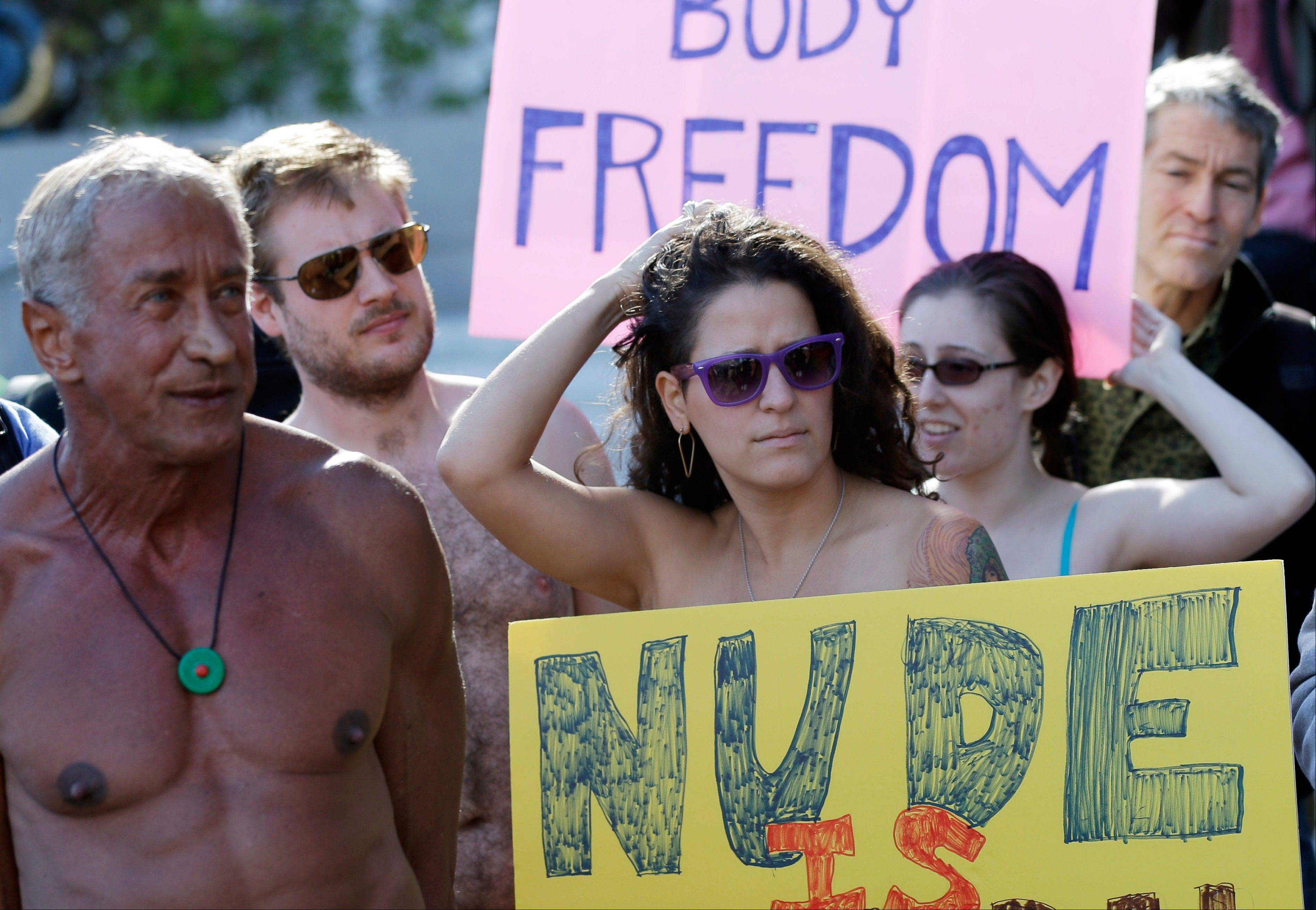 Demonstrators gather outside of City Hall in San Francisco for a protest against a proposed city-wide nudity ban, Wednesday.