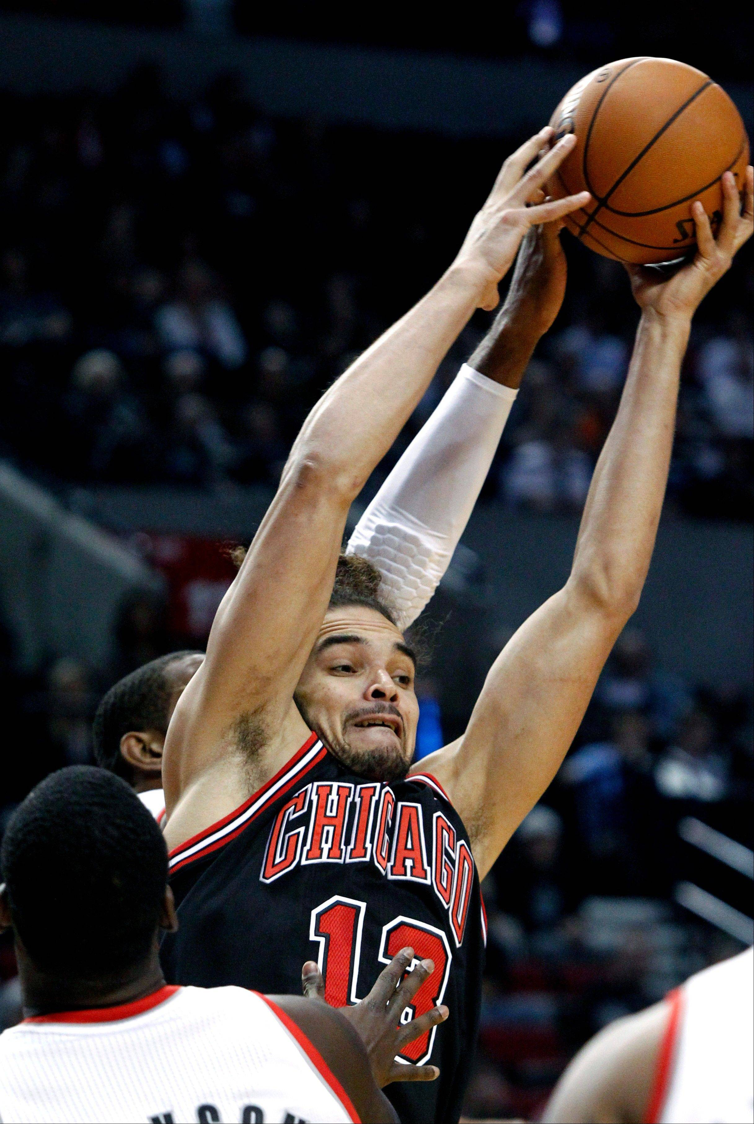 Chicago Bulls center Joakim Noah, right, pulls in an offensive rebound against Portland Trail Blazers forward LaMarcus Aldridge during the first quarter in Portland, Ore., Sunday.