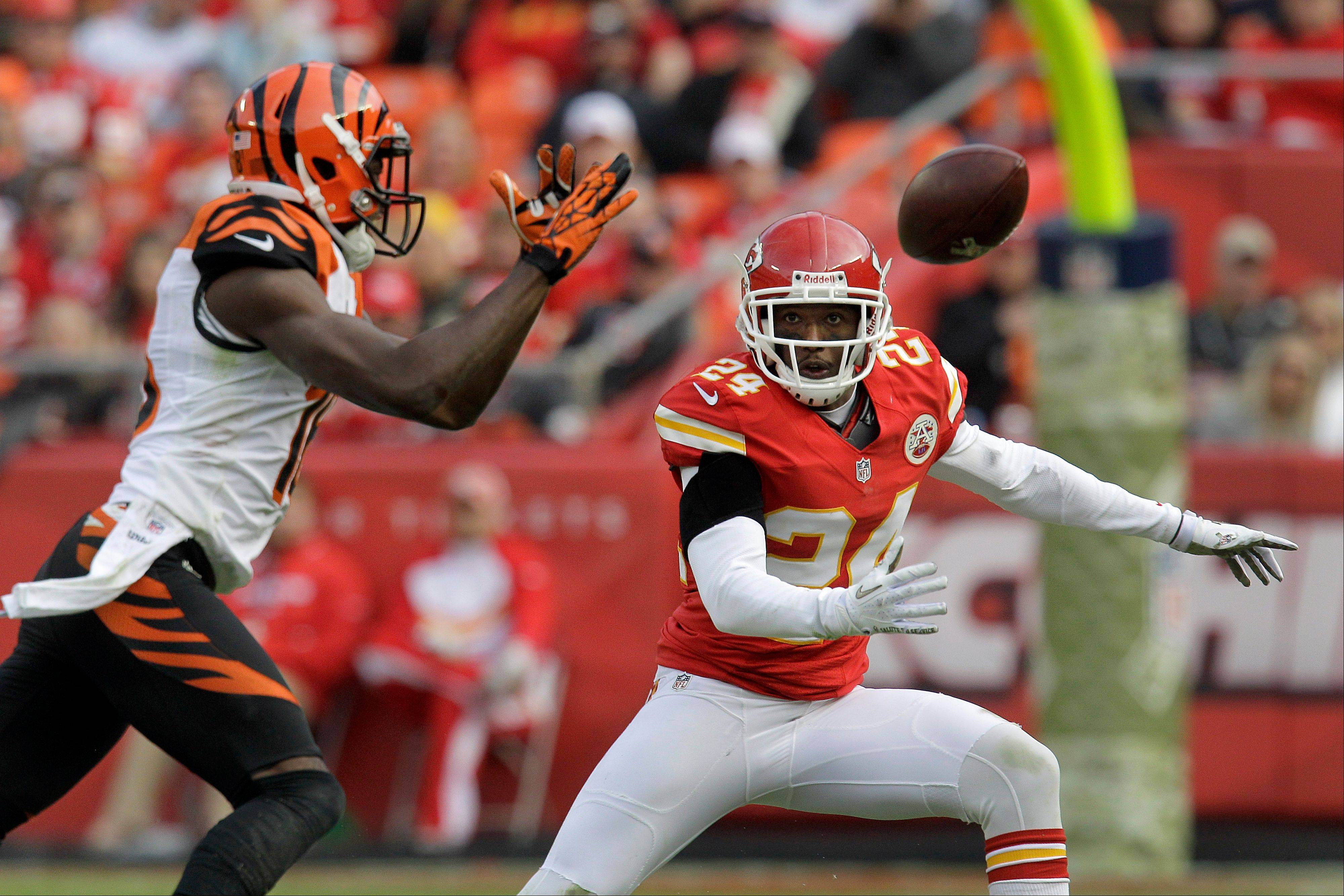 Kansas City Chiefs cornerback Brandon Flowers (24) and Cincinnati Bengals wide receiver A.J. Green chase a pass intended for Green during the second half Sundayin Kansas City, Mo.